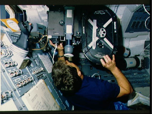 STS-29 Discovery, OV-103, Pilot Blaha with IMAX camera on aft flight deck