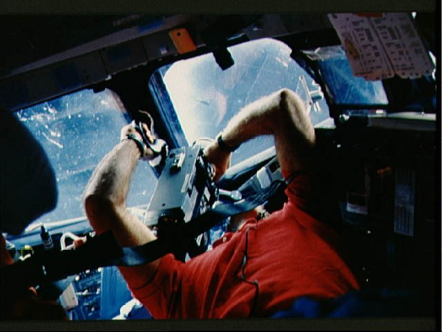 STS-29 Discovery, OV-103, MS Bagian uses video camera on forward flight deck