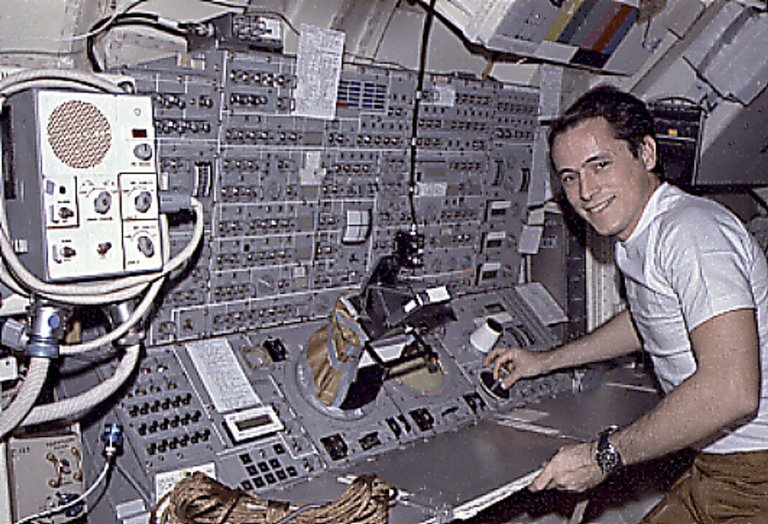 Skylab-4 Mission Onboard Photograph - Astronaut Ed Gibson at Work
