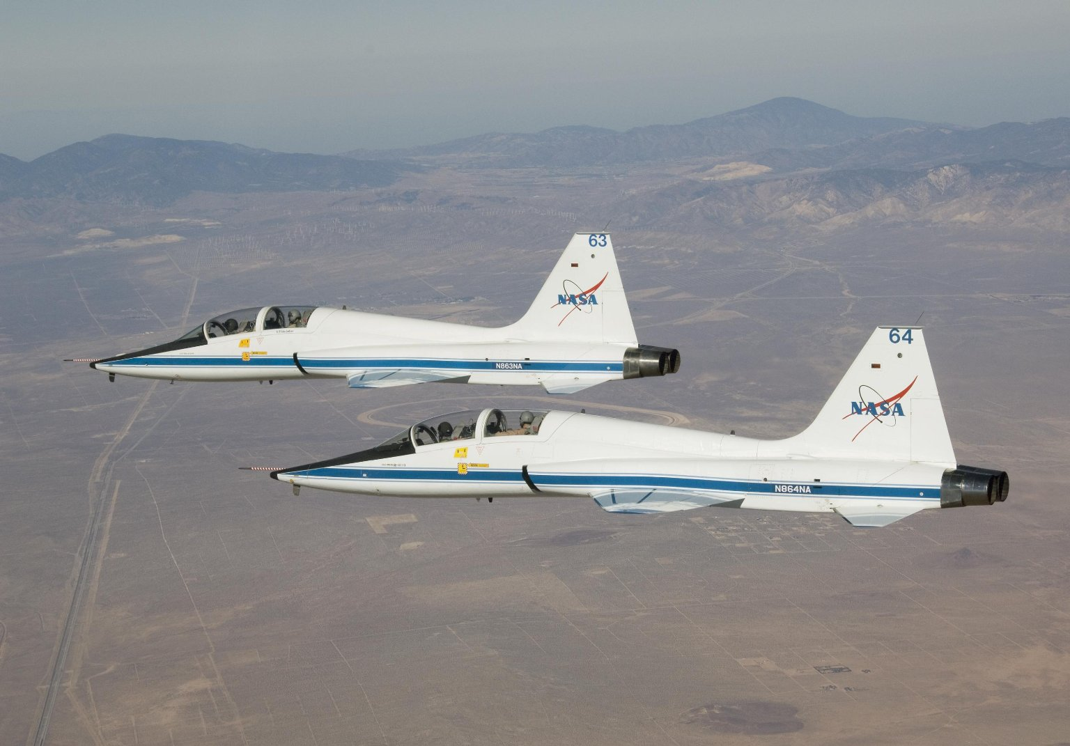 Two T-38A Mission Support Aircraft Fly in Tight Formation.