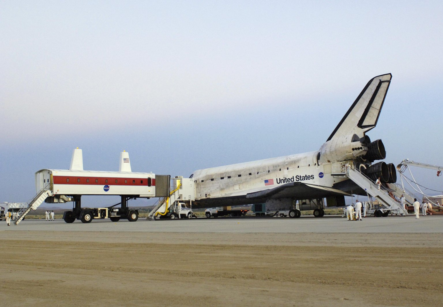 NASA's Crew Transport Vehicle Pulls Up to the Shuttle Discovery.