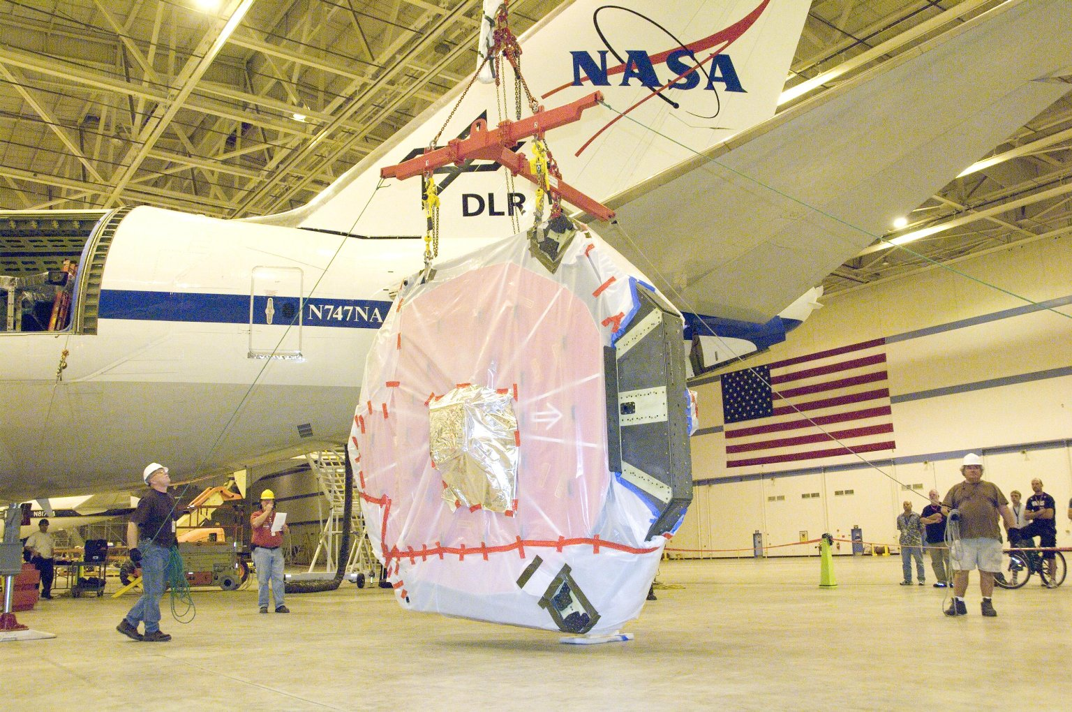 A Crane Lifts SOFIA's Newly Coated Primary Mirror Assembly.