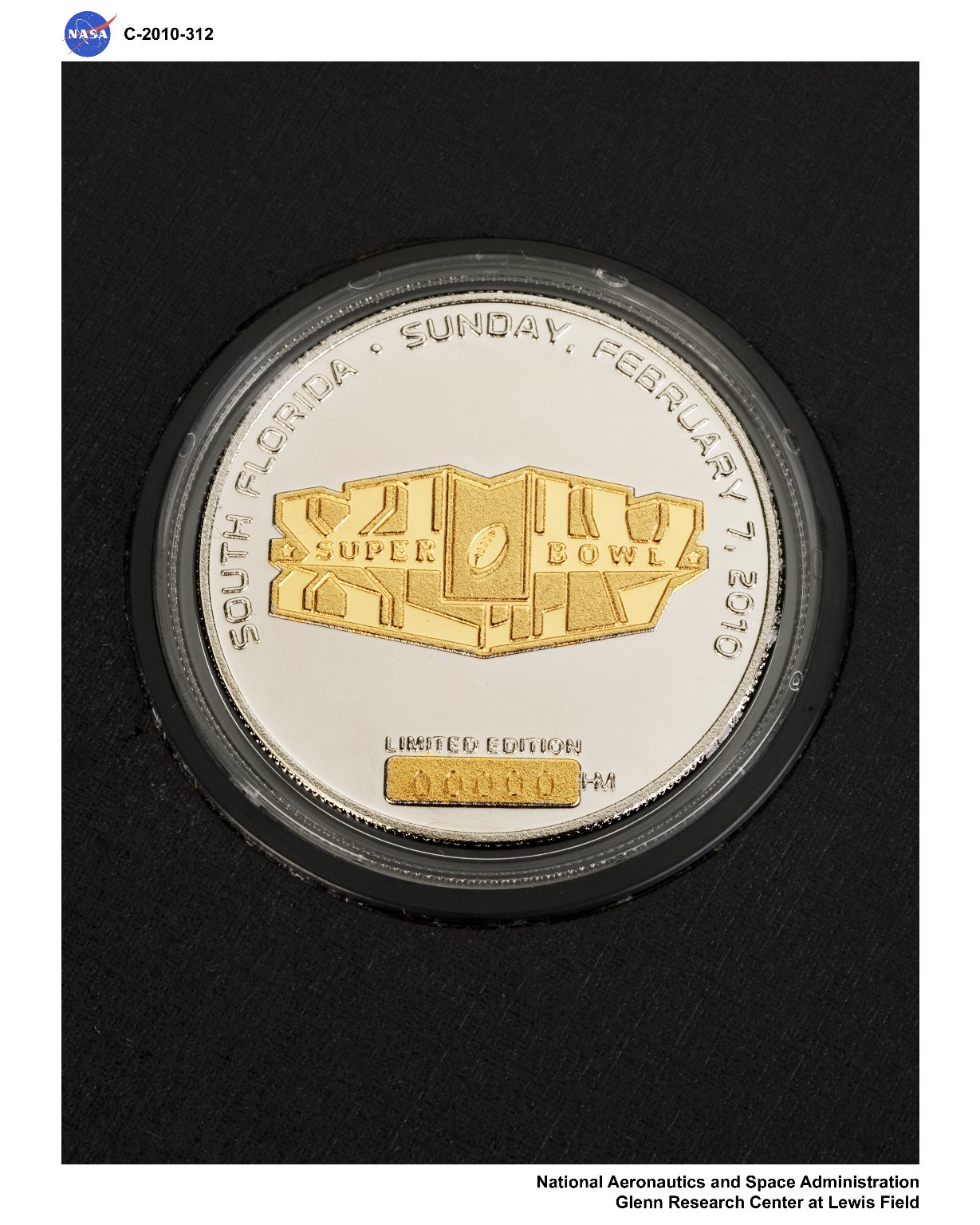 Super Bowl XLIV Game Coin which flew on STS-129