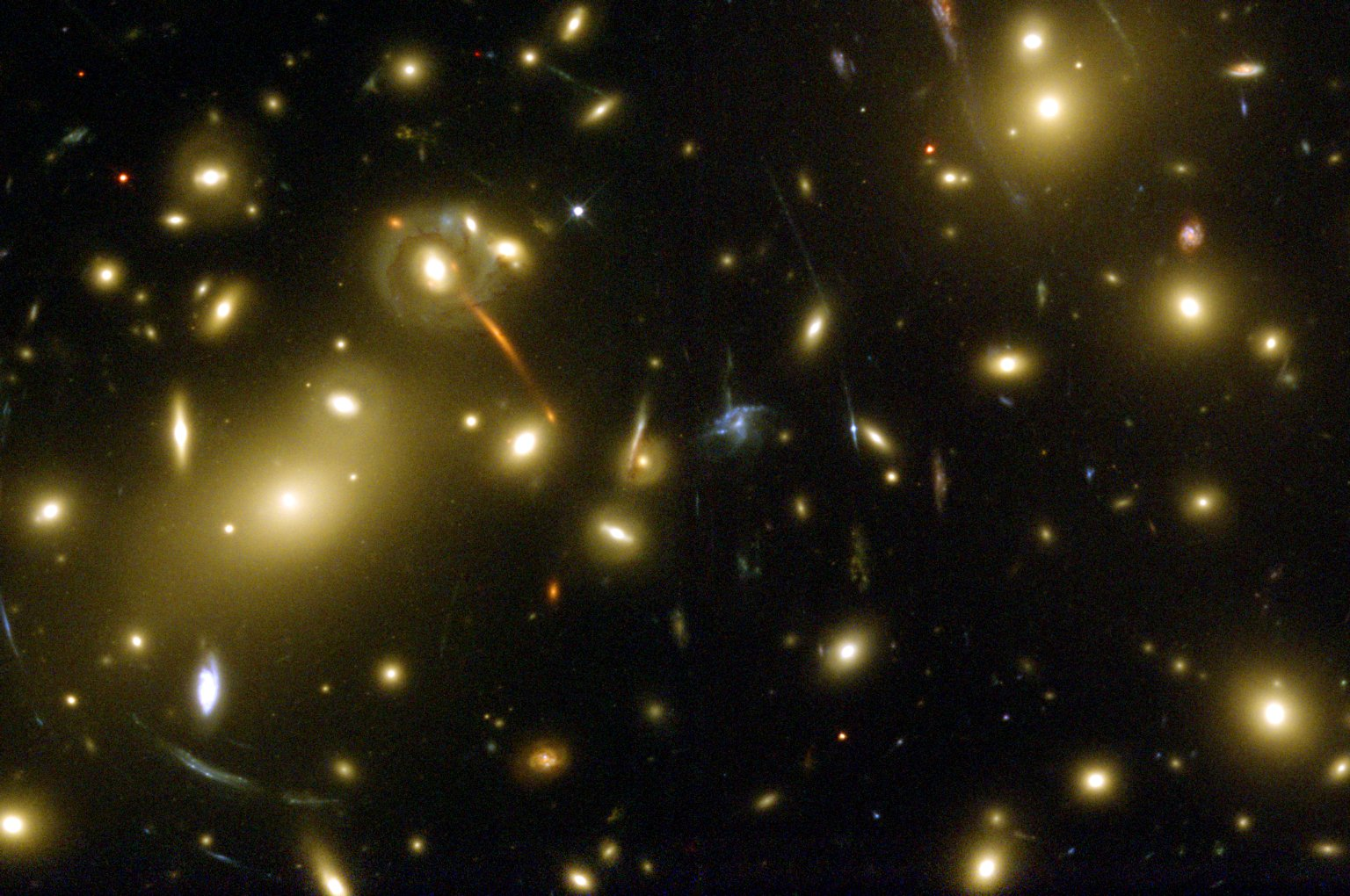 Gravitational Lens Helps Hubble and Keck Discover Galaxy Building Block