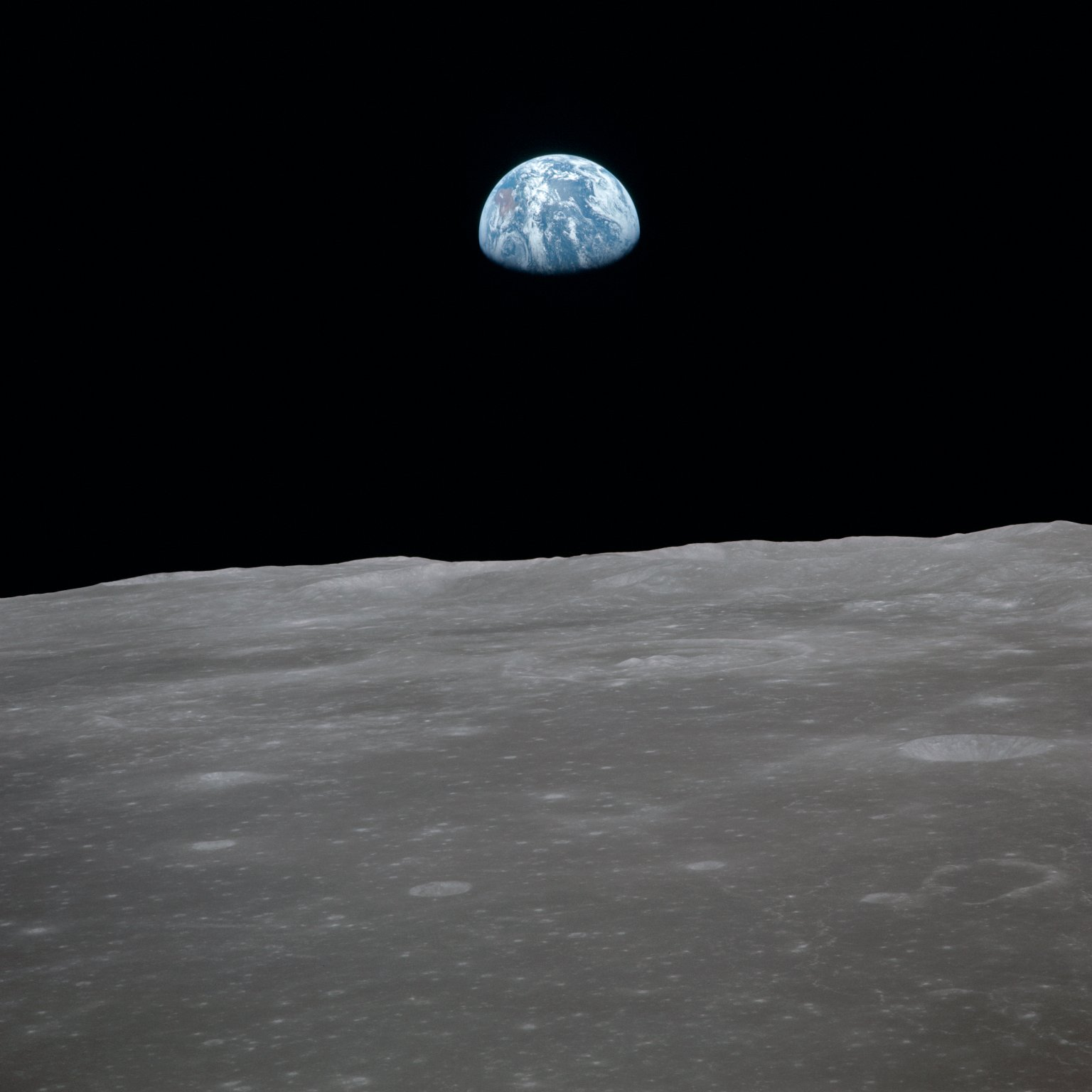 Apollo 11 Mission image - View of moon limb,with Earth on the horizon,Mare Smythii Region