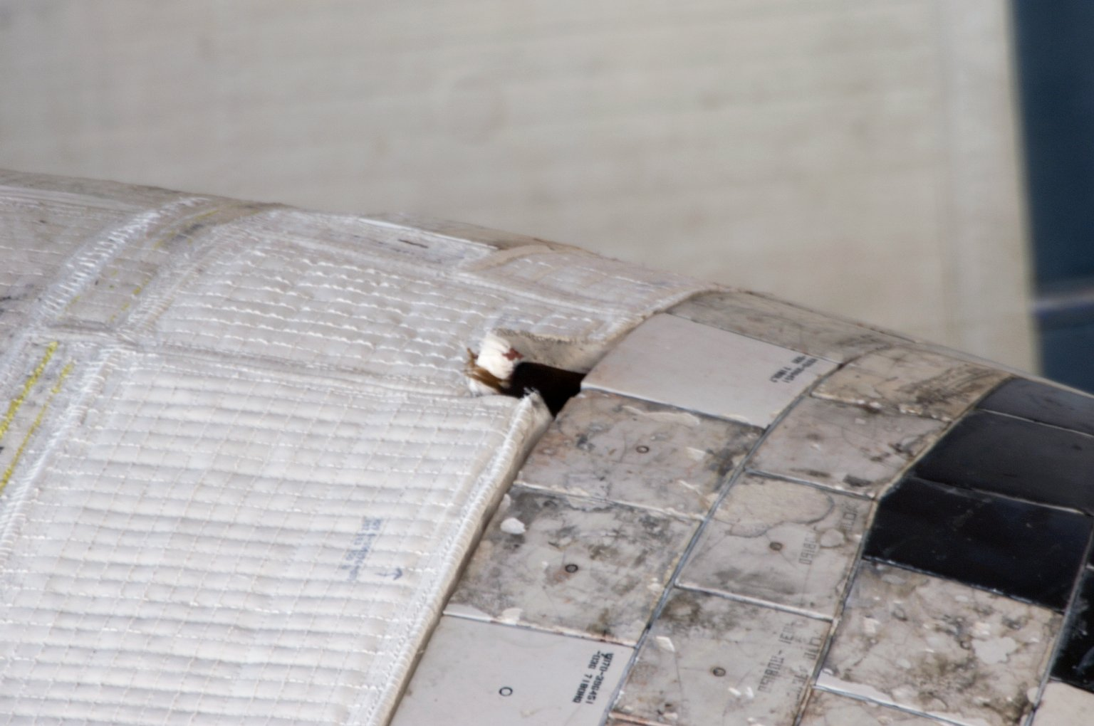 Damaged thermal blanket noted on port OMS Pod on STS-117 Space Shuttle Atlantis