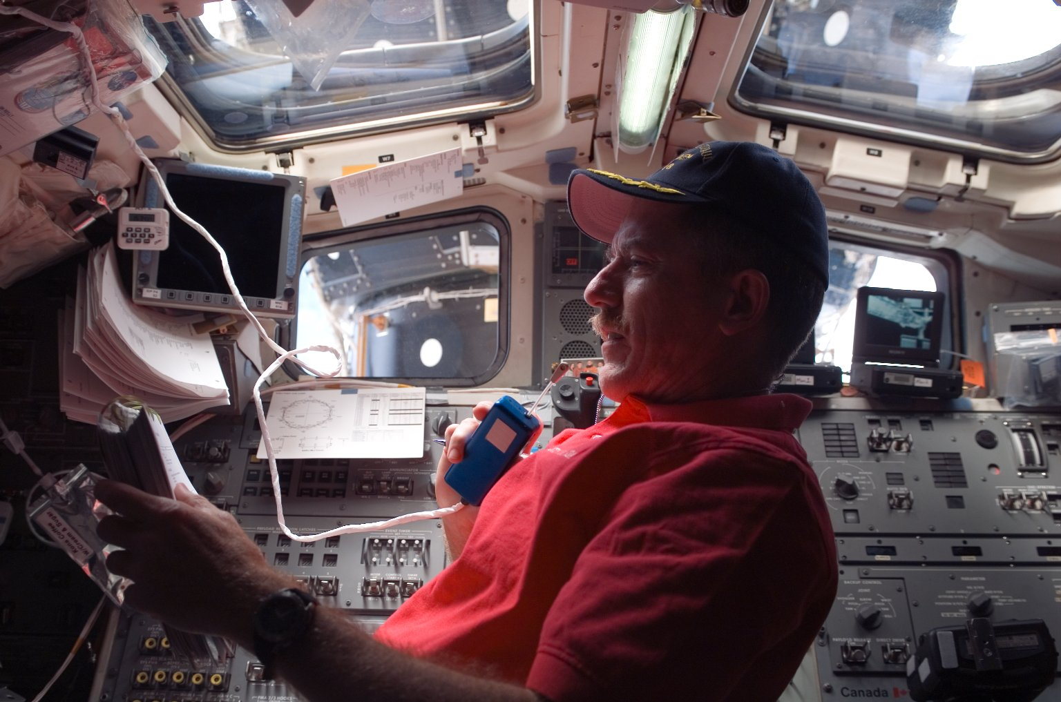 Reilly uses communication equipment in the aft FD during EVA 4