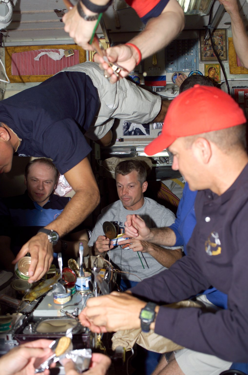 Kotov, Olivas, Swanson, and Sturckow enjoy a meal in the SM during Joint Operations