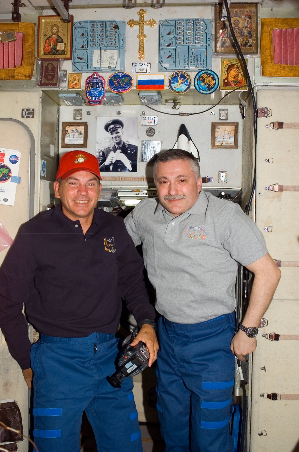 Sturckow and Yurchikhin pose in hatch area of the SM during Joint Operations