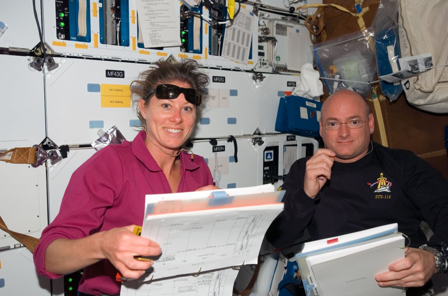 View of Kelly and Caldwell working in the MDDK during STS-118