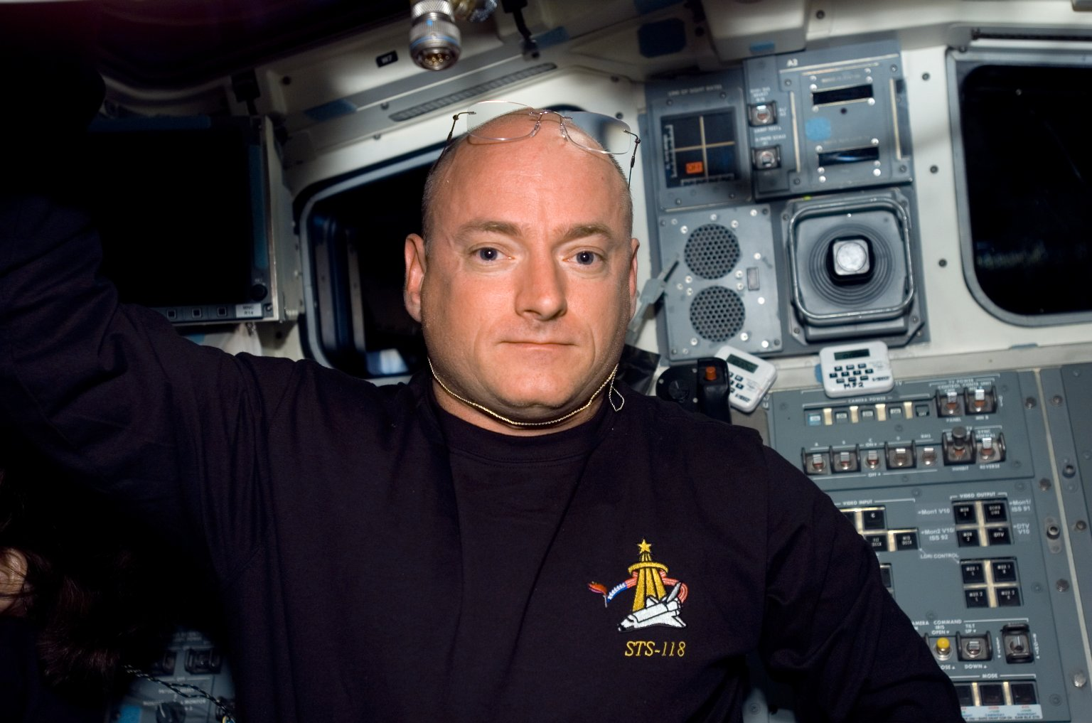 View of Kelly posing for a photo in the FD during STS-118