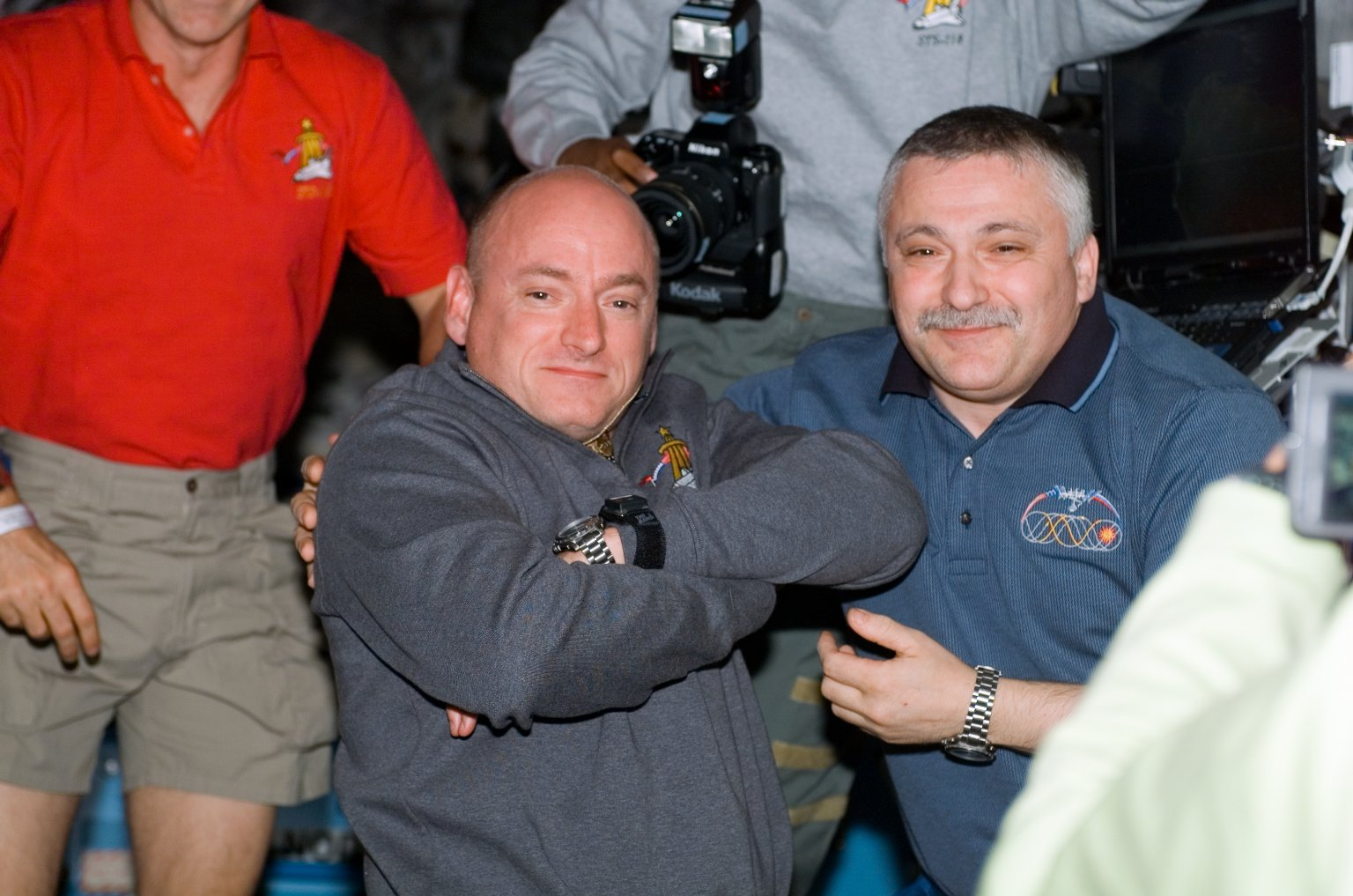 View of Kelly and Yurchikhin posing together during STS-118/Expedition 15 Joint Operations