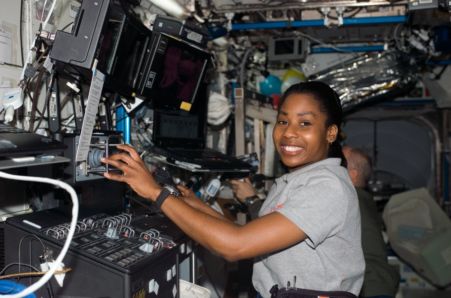 Wilson works at the SSRMS during STS-121 / Expedition 13 joint operations