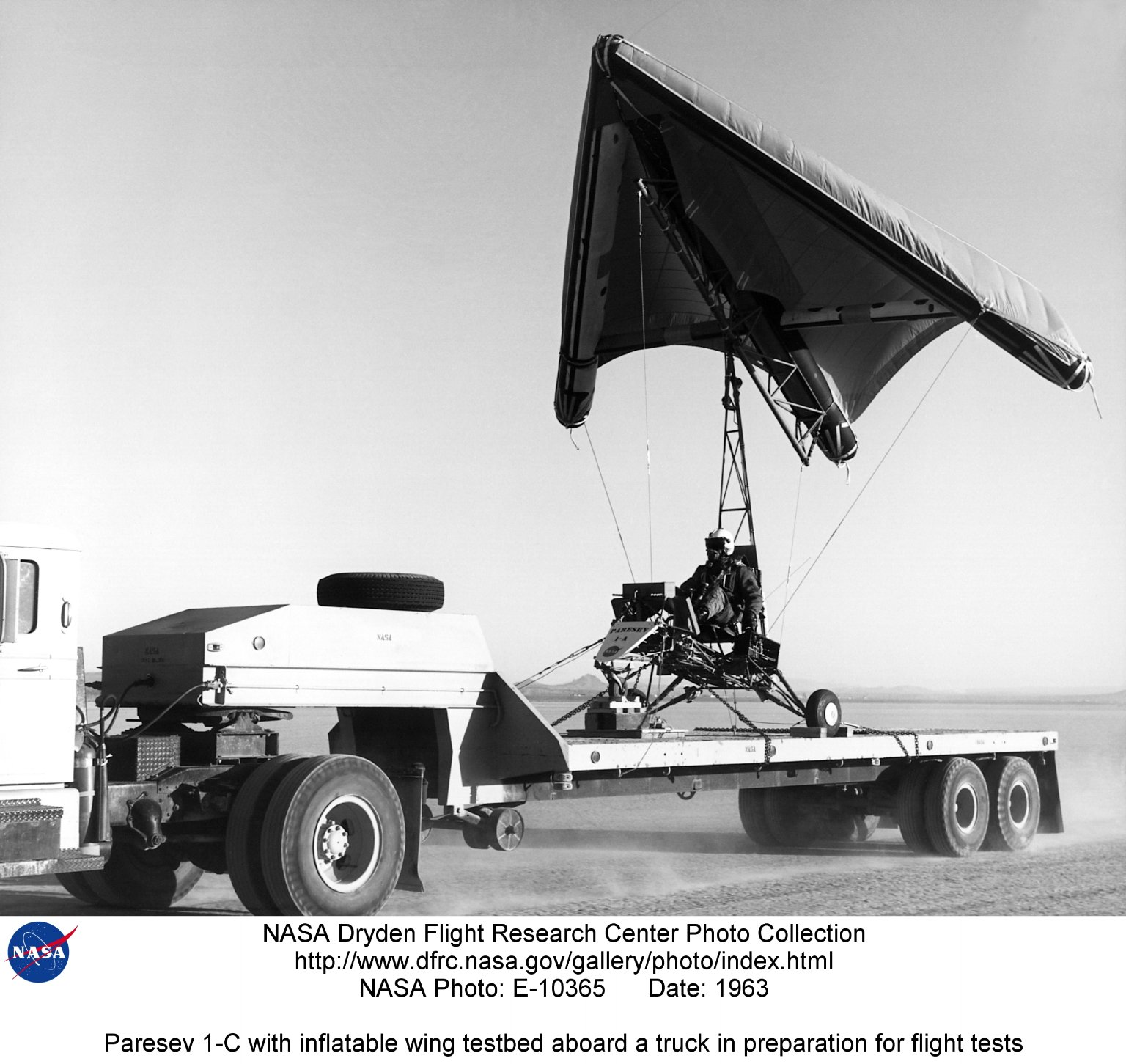 Paresev 1-C with inflatable wing testbed aboard a truck in preparation for flight tests