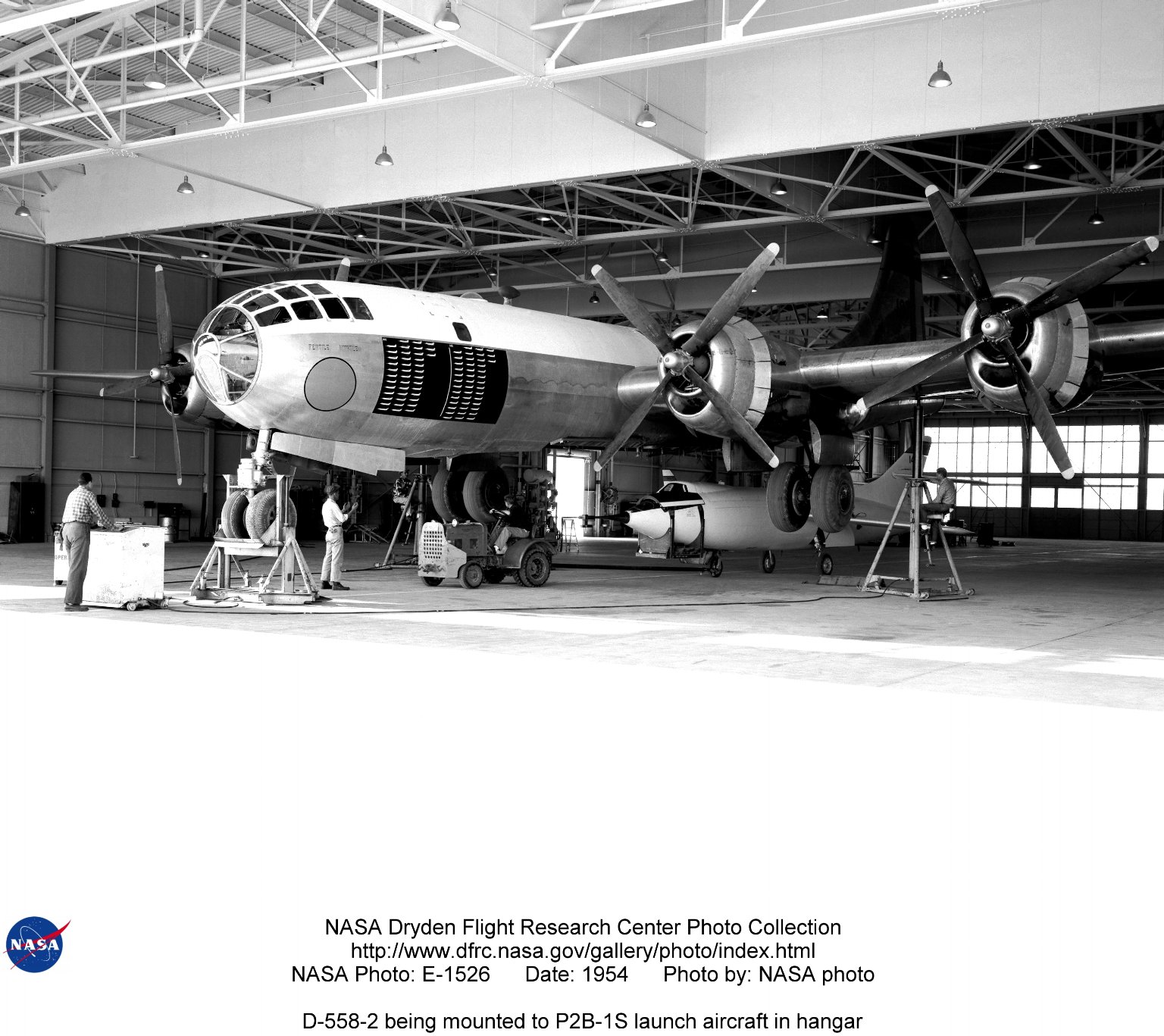 D-558-2 being mounted to P2B-1S launch aircraft in hangar