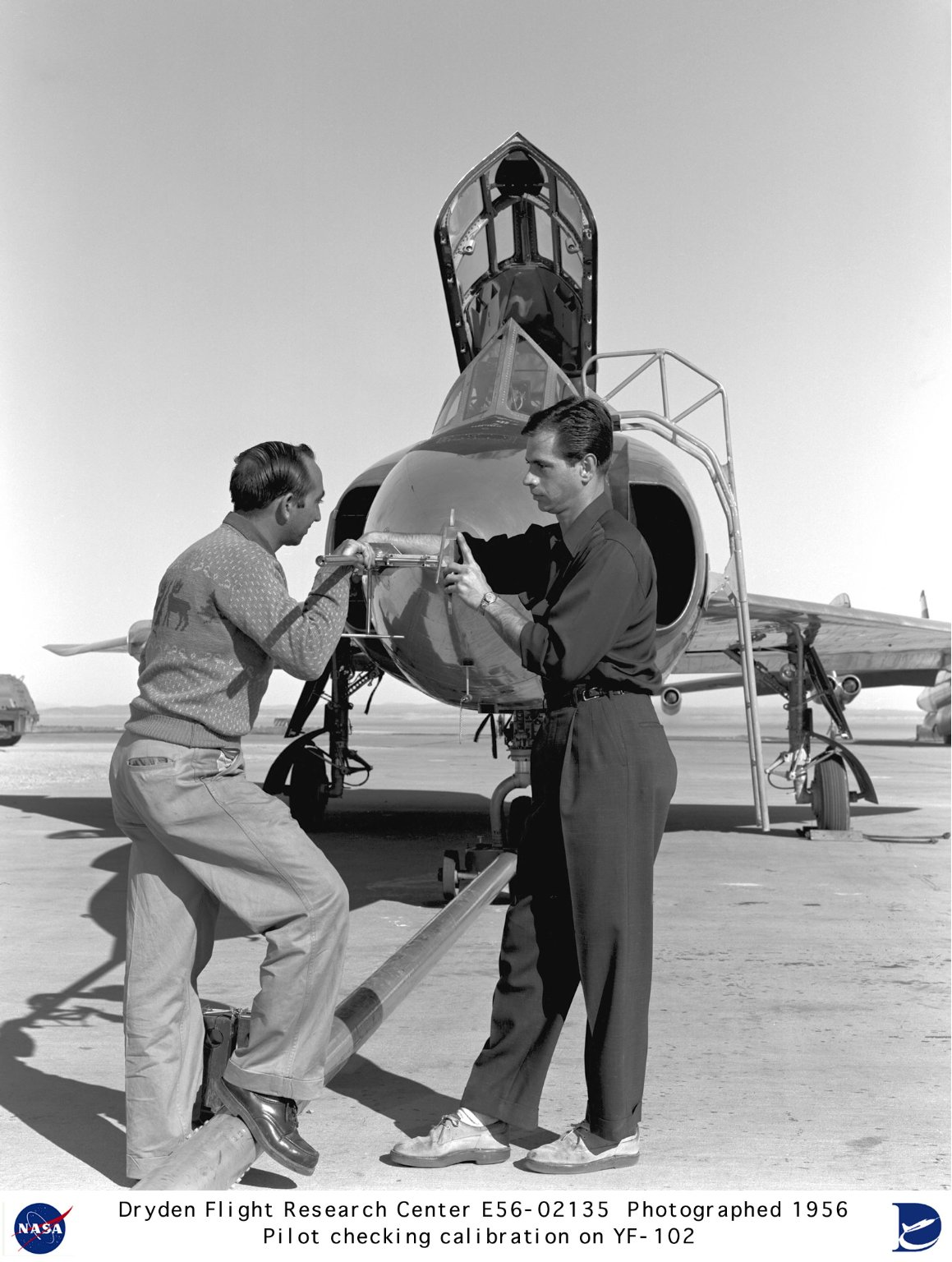 Engineers checking nose boom on YF-102