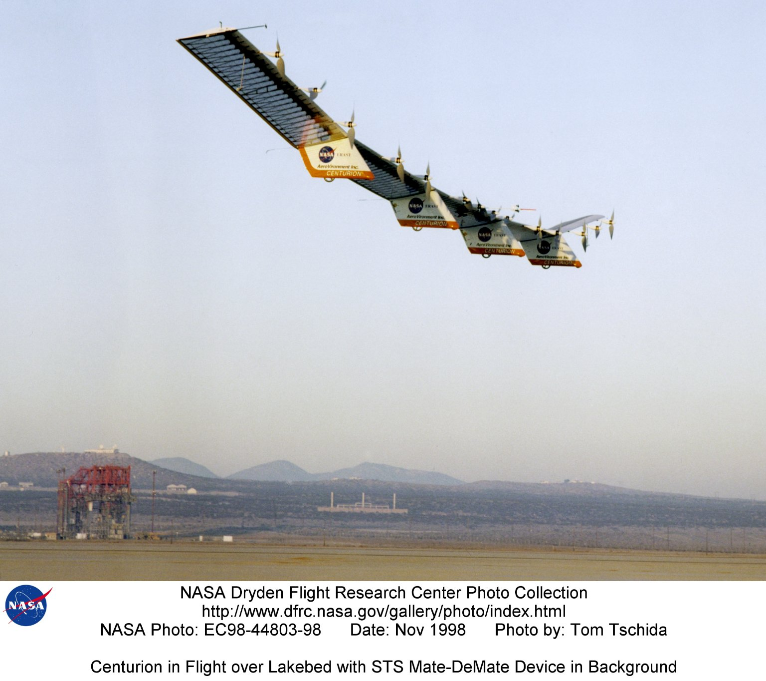 Centurion in Flight over Lakebed with STS Mate-DeMate Device in Background