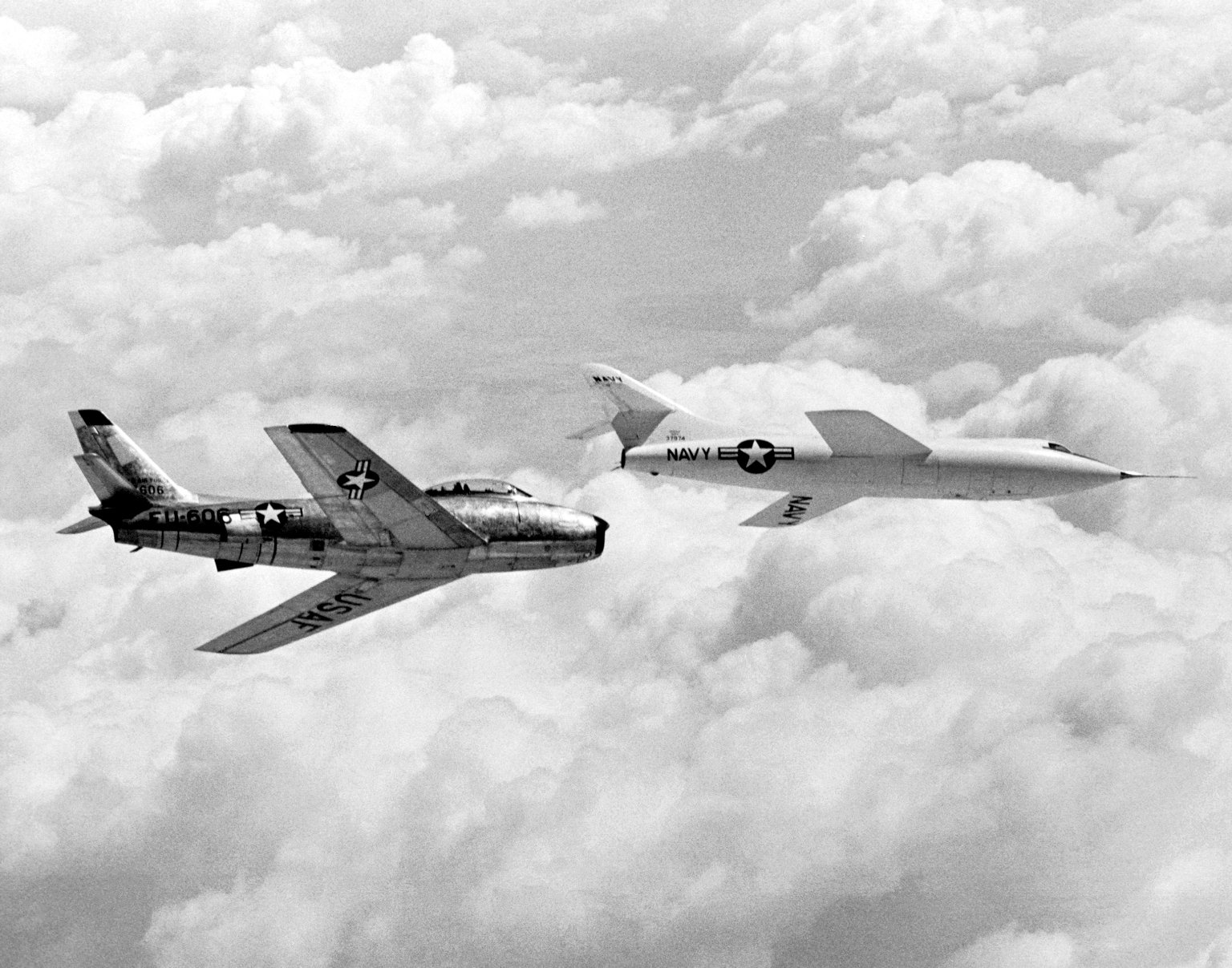 Skyrocket In Flight With F-86 Chase Plane