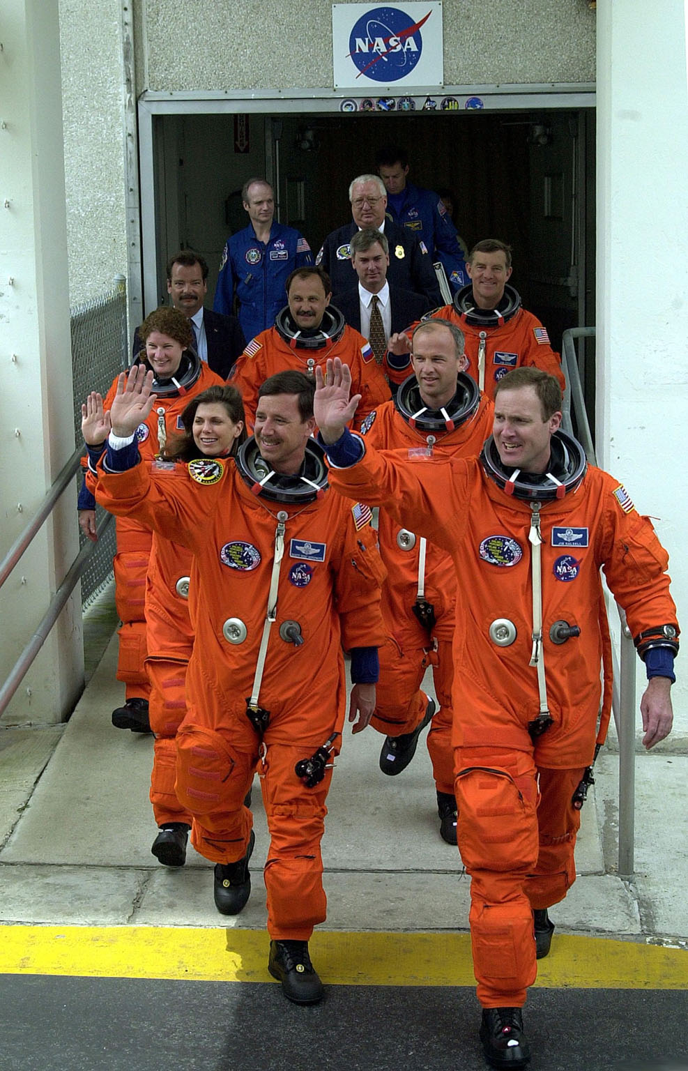 (Nikon D1 Test) The STS-101 crew wave to onlookers as they leave the Operations and Checkout Building enroute for the second time to Launch Pad 39A and another attempt at liftoff of Space Shuttle Atlantis. In their orange launch and entry suits, they are (front line) Pilot Scott J. Horowitz and Commander James D. Halsell Jr.; (second line) Mission Specialists Mary Ellen Weber and Jeffrey N. Williams; and (third line) Mission Specialists Susan J. Helms, Yury Usachev of Russia and James S. Voss The first attempt on April 24 was scrubbed due to unfavorable weather conditions. The mission will take the crew to the International Space Station to deliver logistics and supplies and to prepare the Station for the arrival of the Zvezda Service Module, expected to be launched by Russia in July 2000. Also, the crew will conduct one space walk. This will be the third assembly flight to the Space Station. Liftoff is targeted for 3:52 p.m. EDT. The mission is expected to last about 10 days, with Atlantis landing at KSC Saturday, May 6, about 11:53 a.m. EDT