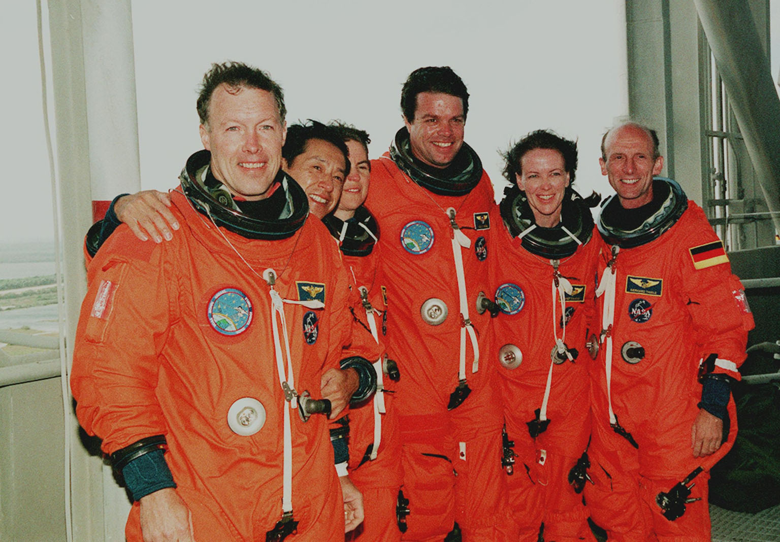 KENNEDY SPACE CENTER, Fla. -- At the 195-foot level of the Fixed Service Structure on Launch Pad 39A, the STS-99 crew pose for a photograph during Terminal Countdown Demonstration Test (TCDT) activities. Standing left to right are Pilot Dominic Gorie, Mission Specialist Mamoru Mohri (Ph.D.), Mission Specialist Janice Voss (Ph.D.), Commander Kevin Kregel, Mission Specialist Janet Lynn Kavandi (Ph.D.), and Mission Specialist Gerhard Thiele (Ph.D.). Thiele is with the European Space Agency and Mohri is with the National Space Development Agency (NASDA) of Japan. The TCDT provides the crew with simulated countdown exercises, emergency egress training, and opportunities to inspect the mission payloads in the orbiter's payload bay. STS-99 is the Shuttle Radar Topography Mission, which will chart a new course, using two antennae and a 200-foot-long section of space station-derived mast protruding from the payload bay to produce unrivaled 3-D images of the Earth's surface. The result of the Shuttle Radar Topography Mission could be close to 1 trillion measurements of the Earth's topography. Besides contributing to the production of better maps, these measurements could lead to improved water drainage modeling, more realistic flight simulators, better locations for cell phone towers, and enhanced navigation safety. Launch of Endeavour on the 11-day mission is scheduled for Jan. 31 at 12:47 p.m. EST