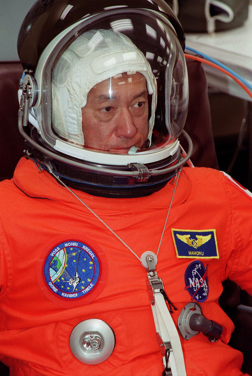 STS-99 Mission Specialist Mamoru Mohri (Ph.D.), who is with the National Space Development Agency (NASDA) of Japan, suits up in the Operations and Checkout Building, as part of a flight crew equipment fit check, prior to his trip to Launch Pad 39A. The crew is taking part in Terminal Countdown Demonstration Test (TCDT) activities that provide the crew with simulated countdown exercises, emergency egress training, and opportunities to inspect the mission payloads in the orbiter's payload bay. STS-99 is the Shuttle Radar Topography Mission, which will chart a new course, using two antennae and a 200-foot-long section of space station-derived mast protruding from the payload bay to produce unrivaled 3-D images of the Earth's surface. The result of the Shuttle Radar Topography Mission could be close to 1 trillion measurements of the Earth's topography. Besides contributing to the production of better maps, these measurements could lead to improved water drainage modeling, more realistic flight simulators, better locations for cell phone towers, and enhanced navigation safety. Launch of Endeavour on the 11-day mission is scheduled for Jan. 31 at 12:47 p.m. EST
