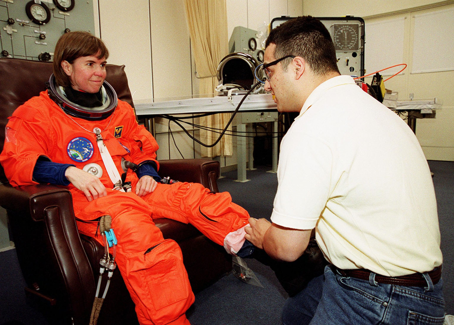 STS-99 Mission Specialist Janice Voss (Ph.D.) suits up in the Operations and Checkout Building, as part of a flight crew equipment fit check, prior to her trip to Launch Pad 39A. The crew is taking part in Terminal Countdown Demonstration Test (TCDT) activities that provide the crew with simulated countdown exercises, emergency egress training, and opportunities to inspect the mission payloads in the orbiter's payload bay. STS-99 is the Shuttle Radar Topography Mission, which will chart a new course, using two antennae and a 200-foot-long section of space station-derived mast protruding from the payload bay to produce unrivaled 3-D images of the Earth's surface. The result of the Shuttle Radar Topography Mission could be close to 1 trillion measurements of the Earth's topography. Besides contributing to the production of better maps, these measurements could lead to improved water drainage modeling, more realistic flight simulators, better locations for cell phone towers, and enhanced navigation safety. Launch of Endeavour on the 11-day mission is scheduled for Jan. 31 at 12:47 p.m. EST
