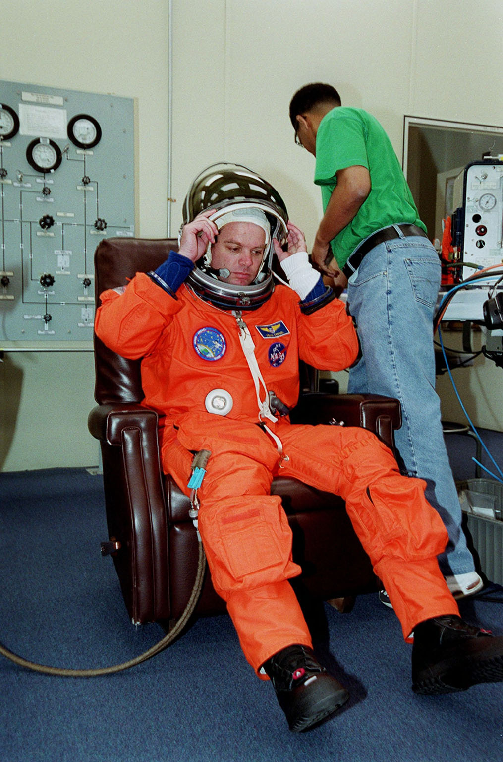 STS-99 Mission Commander Kevin Kregel suits up in the Operations and Checkout Building, as part of a flight crew equipment fit check, prior to his trip to Launch Pad 39A. The crew is taking part in Terminal Countdown Demonstration Test (TCDT) activities that provide the crew with simulated countdown exercises, emergency egress training, and opportunities to inspect the mission payloads in the orbiter's payload bay. STS-99 is the Shuttle Radar Topography Mission, which will chart a new course, using two antennae and a 200-foot-long section of space station-derived mast protruding from the payload bay to produce unrivaled 3-D images of the Earth's surface. The result of the Shuttle Radar Topography Mission could be close to 1 trillion measurements of the Earth's topography. Besides contributing to the production of better maps, these measurements could lead to improved water drainage modeling, more realistic flight simulators, better locations for cell phone towers, and enhanced navigation safety. Launch of Endeavour on the 11-day mission is scheduled for Jan. 31 at 12:47 p.m. EST