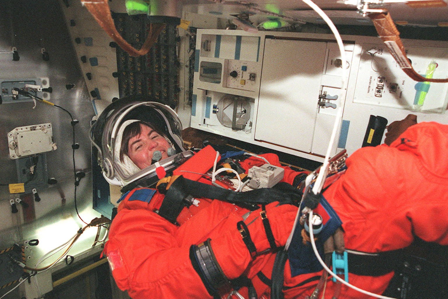 KENNEDY SPACE CENTER, FLA. -- STS-99 Mission Specialist Janice Voss (Ph.D.) settles into her seat inside Space Shuttle Endeavour for a practice launch countdown during Terminal Countdown Demonstration Test (TCDT) activities for the mission. The TCDT includes a simulation of the final launch countdown. STS-99 is the Shuttle Radar Topography Mission, which will chart a new course, using two antennae and a 200-foot-long section of the Space Station-derived mast protruding from the payload bay to produce unrivaled 3-D images of the Earth's surface. The result of the Shuttle Radar Topography Mission could be close to 1 trillion measurements of the Earth's topography. Besides contributing to the production of better maps, these measurements could lead to improved water drainage modeling, more realistic flight simulators, better locations for cell phone towers, and enhanced navigation safety. Launch of Endeavour on the 11-day mission is scheduled for Jan. 31 at 12:47 p.m. EST.