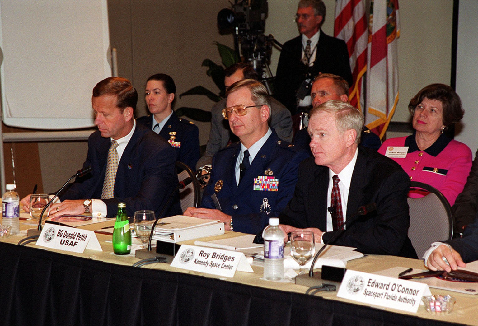 Taking part in the First Florida Space Summit on the future of space as it relates to the State of Florida are (left to right) Lt. Governor Frank Brogan, 45th Space Wing Commander Brig. Gen. Donald Pettit, and Center Director Roy Bridges, who moderated the discussion. The event, held at the Kennedy Space Center Visitor Complex, also included Senator Bob Graham, Senator Connie Mack, State Senator Patsy Kurth, Representative Dave Weldon, and heads of aerospace companies
