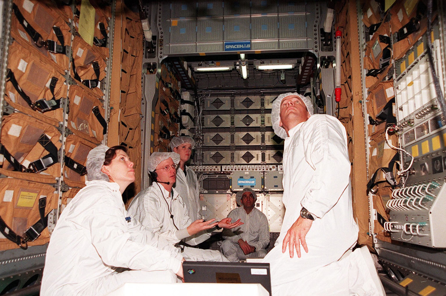 Members of the STS-101 crew look over equipment inside the SPACEHAB double module, part of the cargo on their mission. At left is Mission Specialist Mary Ellen Weber and at right is Mission Specialist Jeffrey Williams. They are taking part in Crew Equipment Interface Test (CEIT) activities to become familiar with equipment for their mission to the International Space Station. Other crew members not shown are Commander James Halsell, Pilot Scott Horowitz, and Mission Specialists James Voss, Susan Helms and Yuri Usachev. The STS-101 crew will be responsible for preparing the Space Station for the arrival of the Zvezda Service Module, expected to be launched by Russia in July 2000. Also, the crew will conduct one space walk to perform maintenance on the Space Station and deliver logistics and supplies. This will be the third assembly flight for the Space Station. STS-101 is scheduled to launch no earlier than April 13 from Launch Pad 39A
