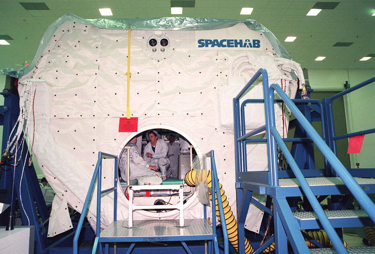 KENNEDY SPACE CENTER, FLA. -- As part of Crew Equipment Interface Test (CEIT) activities at SPACEHAB, in Cape Canaveral, Fla., members of the STS-101 crew spend time inside the SPACEHAB double module to become familiar with equipment for their mission to the International Space Station. The crew of seven comprises Commander James Halsell, Pilot Scott Horowitz, and Mission Specialists Mary Ellen Weber, James Voss, Jeffrey Williams, Susan Helms and Yuri Usachev. The STS-101 crew will be responsible for preparing the Space Station for the arrival of the Zvezda Service Module, expected to be launched by Russia in July 2000. Also, the crew will conduct one space walk to perform maintenance on the Space Station and deliver logistics and supplies. This will be the third assembly flight for the Space Station. STS-101 is scheduled to launch no earlier than April 13 from Launch Pad 39A