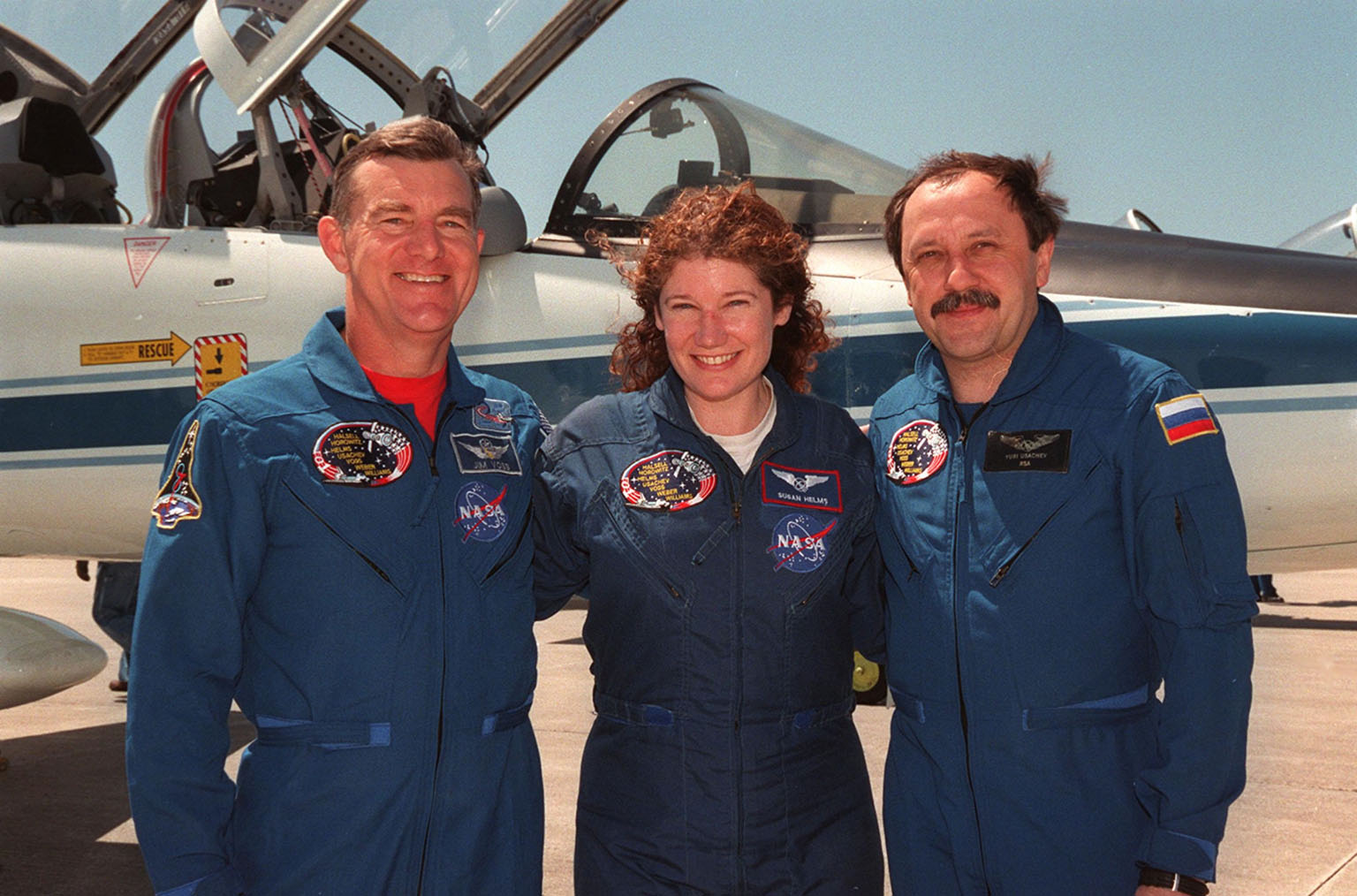 KENNEDY SPACE CENTER, FLA. -- Posing on the tarmac at the Shuttle Landing Facility after their arrival aboard T-38 jets (in the background) are STS-101 Mission Specialists James Voss, Susan Helms and Yury Usachev. They and the rest of the crew are at KSC to take part in Terminal Countdown Demonstration Test (TCDT) activities that include emergency egress training and a dress rehearsal for launch. The other crew members are Commander James Halsell, Pilot Scott Horowitz, and Mission Specialists Mary Ellen Weber and Jeffrey Williams. During their mission to the International Space Station, the STS-101 crew will be delivering logistics and supplies, plus preparing the Station for the arrival of the Zvezda Service Module, expected to be launched by Russia in July 2000. Also, the crew will conduct one space walk to perform maintenance on the Space Station. This will be the third assembly flight for the Space Station. STS-101 is scheduled to launch April 24 at 4:15 p.m. from Launch Pad 39A