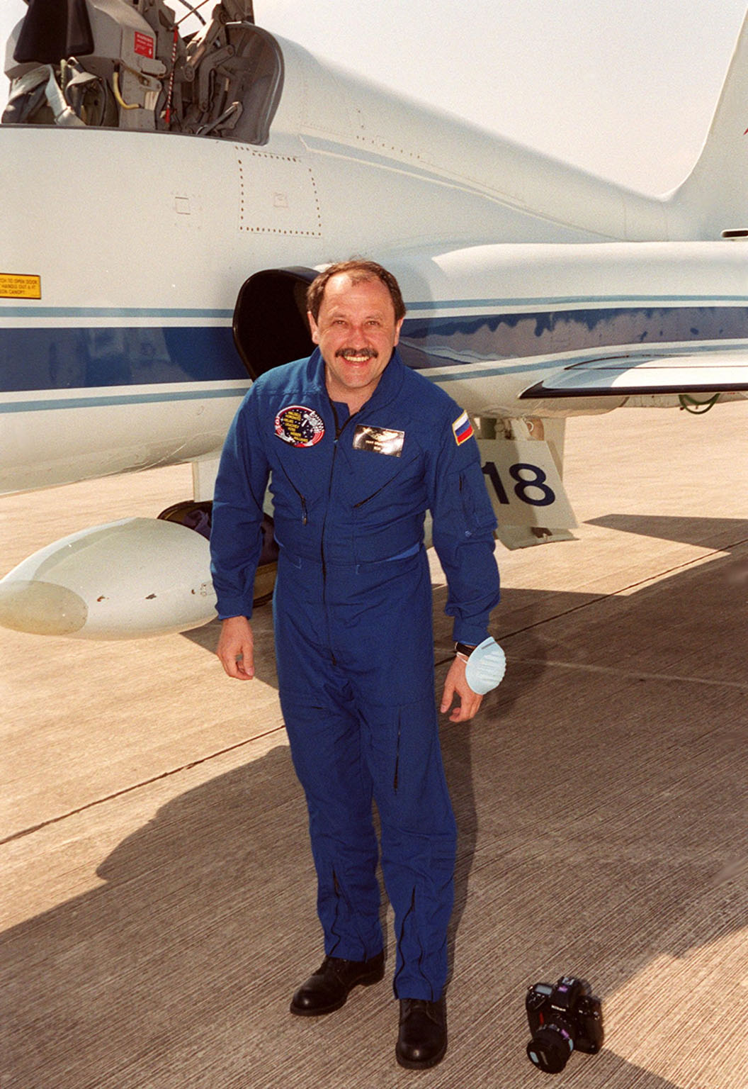 STS-101 Yury Usachev of Russia smiles on his arrival at KSC's Shuttle Landing Facility aboard the T-38 jet aircraft behind him. He and the rest of the crew are at KSC to get ready for their launch on April 24 about 4:15 p.m. EDT from Launch Pad 39A. The mission will take the crew to the International Space Station, delivering logistics and supplies, plus preparing the Station for the arrival of the Zvezda Service Module, expected to be launched by Russia in July 2000. Also, the crew will conduct one space walk to perform maintenance on the Space Station. This will be the third assembly flight for the Space Station