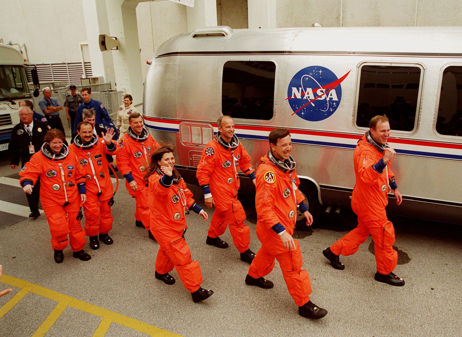 Waving to onlookers, the STS-101 crew eagerly walk to the waiting Astrovan that will take them to Launch Pad 39A and the second attempt at liftoff of Space Shuttle Atlantis. In their orange launch and entry suits, they are (left to right) Mission Specialists Susan J. Helms, Yury Usachev, James S. Voss, Mary Ellen Weber and Jeffrey N. Williams; Pilot Scott J. Horowitz; and Commander James D. Halsell Jr. The first launch attempt on April 24 was scrubbed due to unfavorable weather conditions. The mission will take the crew to the International Space Station to deliver logistics and supplies and to prepare the Station for the arrival of the Zvezda Service Module, expected to be launched by Russia in July 2000. Also, the crew will conduct one space walk. This will be the third assembly flight to the Space Station. Liftoff is targeted for 3:52 p.m. EDT. The mission is expected to last about 10 days, with Atlantis landing at KSC Saturday, May 6, about 11:53 a.m. EDT