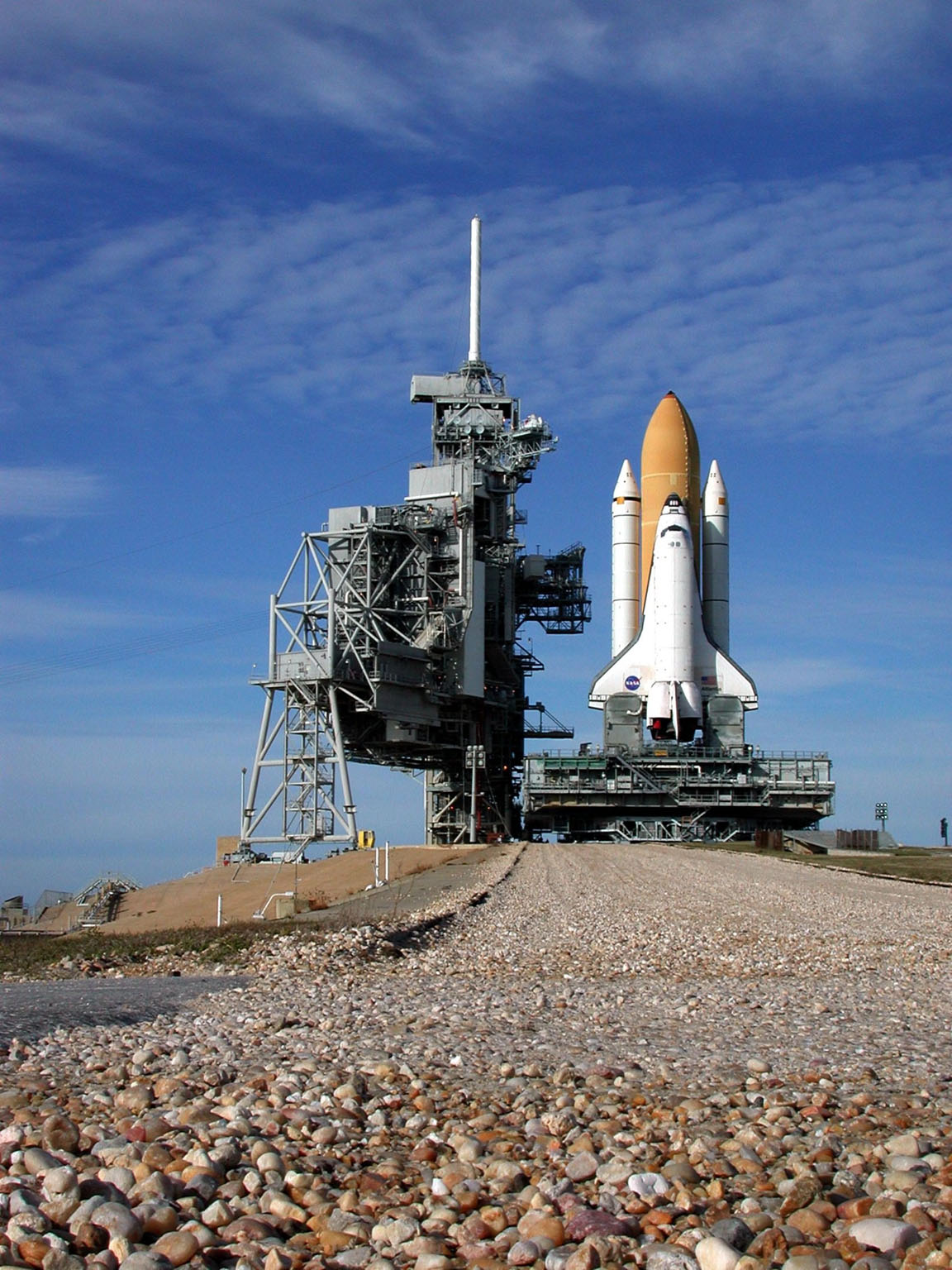 KENNEDY SPACE CENTER, Fla. -- At the top of the incline to Launch Pad 39A, Space Shuttle Atlantis nears the Rotating Service Structure (left). Atlantis will fly on mission STS-98, the seventh construction flight to the International Space Station, carrying the U.S. Laboratory, named Destiny. The lab will have five system racks already installed inside the module. After delivery of electronics in the lab, electrically powered attitude control for Control Moment Gyroscopes will be activated. Atlantis is scheduled for launch no earlier than Jan. 19, 2001, with a crew of five