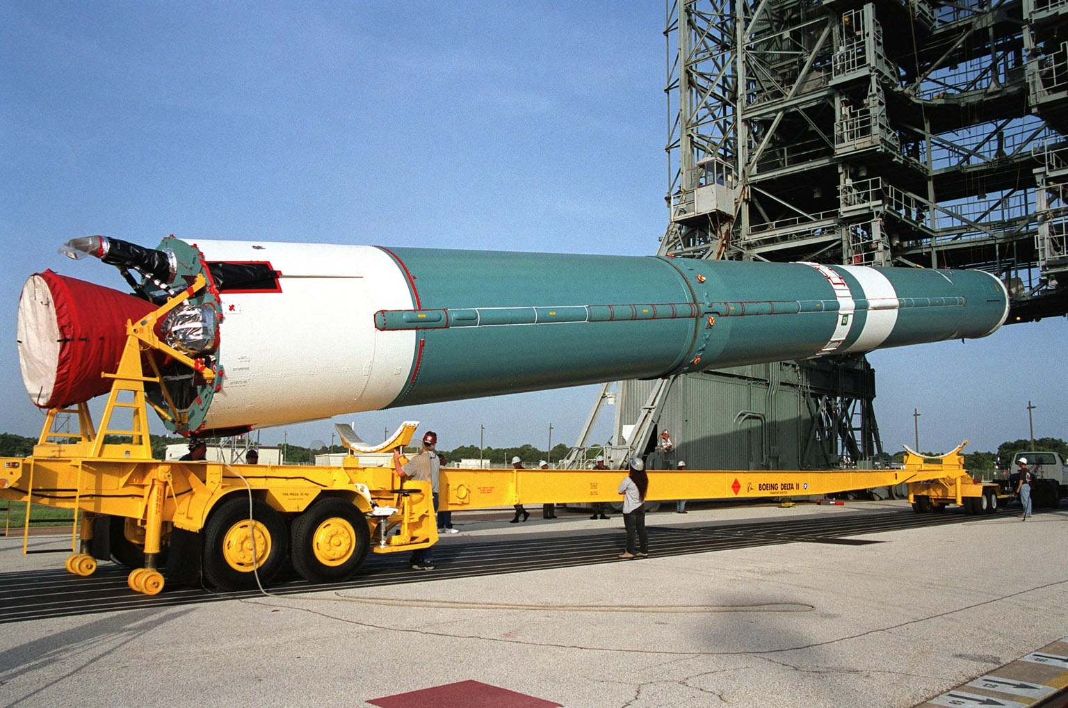 KENNEDY SPACE CENTER, Fla. -- The first stage of a Boeing Delta II rocket arrives on Launch Complex 17A, Cape Canaveral Air Force Station. The rocket will propel the Genesis spacecraft on a journey to capture samples of the ions and elements in the solar wind and return them to Earth for scientists to use to determine the exact composition of the Sun and the solar system?s origin. NASA's Genesis project in managed by the Jet Propulsion Laboratory in Pasadena, Calif. Lockheed Martin Astronautics built the Genesis spacecraft for NASA in Denver, Colo. The launch is scheduled for July 30 at 12:36 p.m. EDT