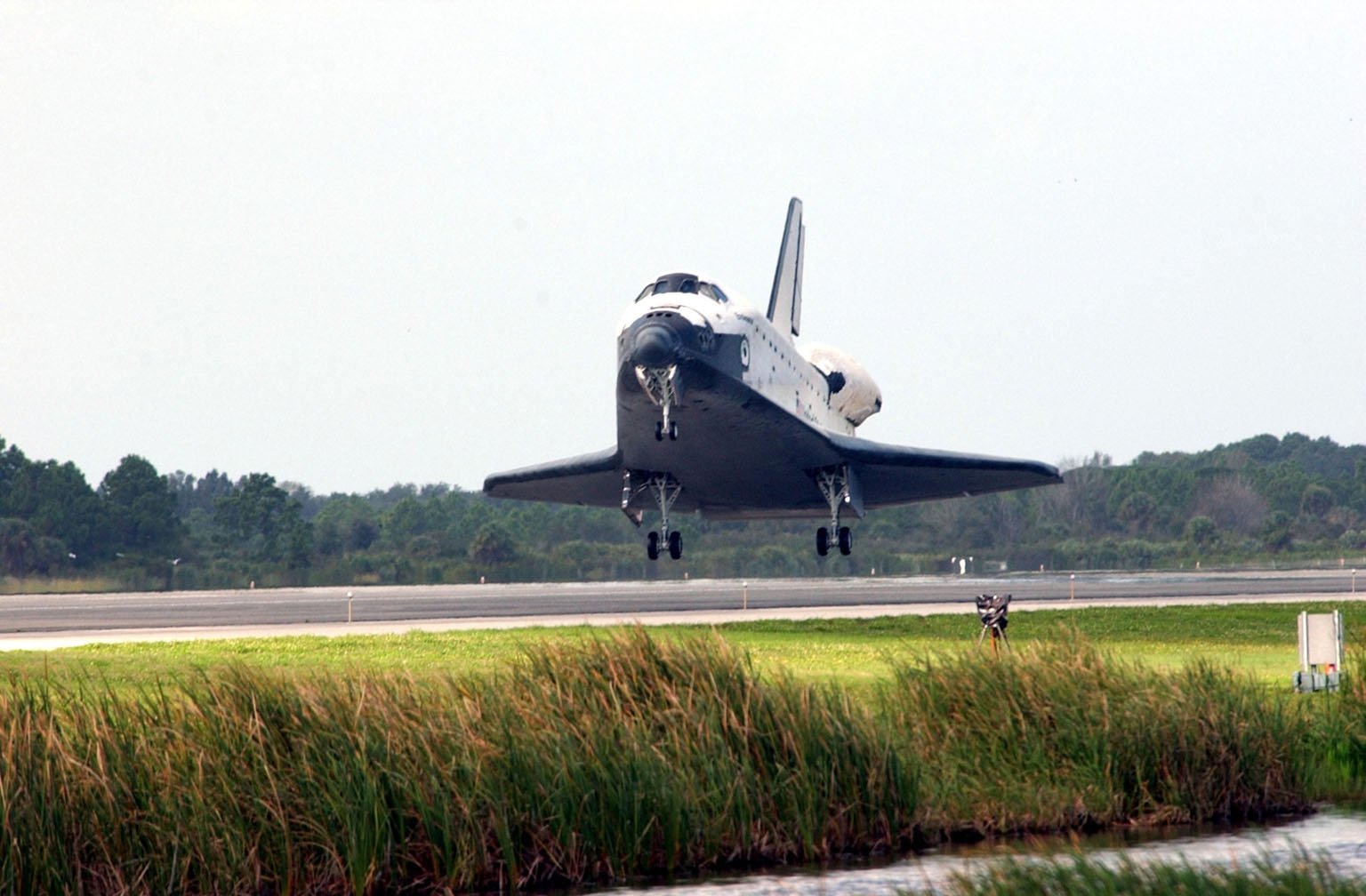 KENNEDY SPACE CENTER, FLA. -- Orbiter Endeavour approaches touchdown on Runway 15 at the KSC Shuttle Landing Facility, completing mission STS-108. After a mission-elapsed time of 11 days, 19 hours and 35 minutes, the landing is the 57th at KSC in the history of the program. Main gear touchdown occurred at 12:55:10 p.m. EST (17:55:10 GMT), nose gear touchdown at 12:55:23 p.m. (17:55:23 GMT) , wheel stop at 12:56:13 p.m. (17:56:13 GMT). STS-108 was the 12th mission to the International Space Station. This mission was the 107th flight in the Shuttle program and the 17th flight for the orbiter. Endeavour carries both the mission crew and the Expedition 3 crew - Commander Frank Culbertson and cosmonauts Vladimir Dezhurov and Mikhail Tyurin - who are returning to Earth after 129 days in space on the Space Station