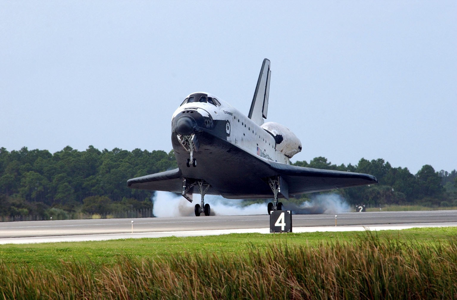 KENNEDY SPACE CENTER, FLA. - Orbiter Endeavour kicks up dust as it touches down on Runway 15 at the KSC Shuttle Landing Facility, completing mission STS-108. After a mission-elapsed time of 11 days, 19 hours and 35 minutes, the landing is the 57th at KSC in the history of the program. Main gear touchdown occurred at 12:55:10 p.m. EST (17:55:10 GMT), nose gear touchdown at 12:55:23 p.m. (17:55:23 GMT) , wheel stop at 12:56:13 p.m. (17:56:13 GMT). STS-108 was the 12th mission to the International Space Station. This mission was the 107th flight in the Shuttle program and the 17th flight for the orbiter. Endeavour carries both the mission crew and the Expedition 3 crew - Commander Frank Culbertson and cosmonauts Vladimir Dezhurov and Mikhail Tyurin - who are returning to Earth after 129 days in space on the Space Station