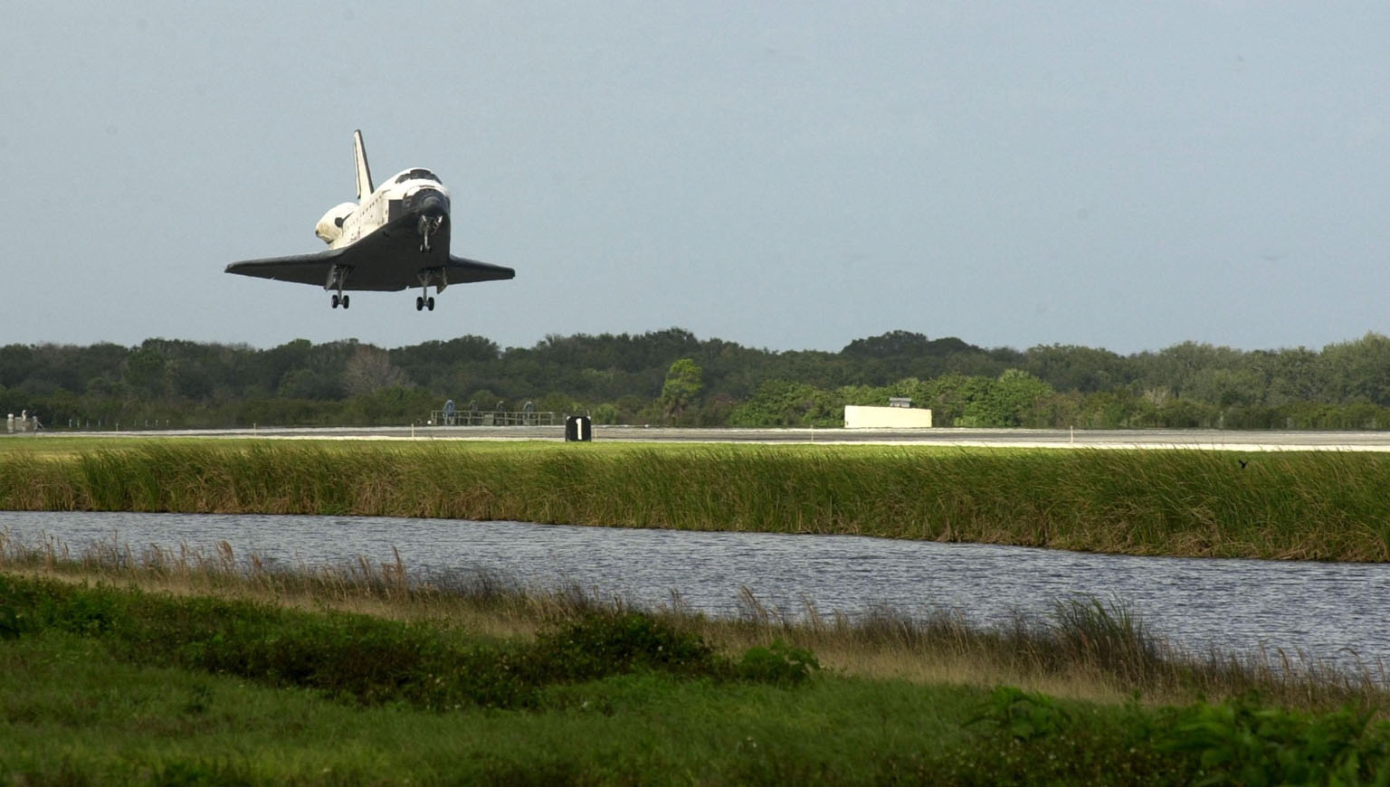 KENNEDY SPACE CENTER, FLA. -- Orbiter Endeavour glides toward touchdown on Runway 15 at the KSC Shuttle Landing Facility, completing mission STS-108. After a mission-elapsed time of 11 days, 19 hours and 35 minutes, the landing is the 57th at KSC in the history of the program. Main gear touchdown occurred at 12:55:10 p.m. EST (17:55:10 GMT), nose gear touchdown at 12:55:23 p.m. (17:55:23 GMT) , wheel stop at 12:56:13 p.m. (17:56:13 GMT). STS-108 was the 12th mission to the International Space Station. This mission was the 107th flight in the Shuttle program and the 17th flight for the orbiter. Endeavour carries both the mission crew and the Expedition 3 crew - Commander Frank Culbertson and cosmonauts Vladimir Dezhurov and Mikhail Tyurin - who are returning to Earth after 129 days in space on the Space Station
