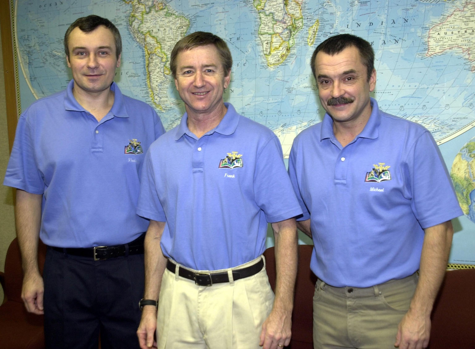 KENNEDY SPACE CENTER, FLA. -- The Expedition 3 crew poses for a group photo one day after their return to Earth from their 129-day stay on the International Space Station. From left are Vladimir Dezhurov, Frank Culbertson and Mikhail Tyurin. They returned aboard the orbiter Endeavour, which landed at KSC at 12:55 p.m. EST (17:55 GMT) Dec. 17, 2001, after completing mission STS-108. The landing is the 57th at KSC in the history of the program STS-108 was the 12th mission to the Space Station. This mission was the 107th flight in the Shuttle program and the 17th flight for the orbiter