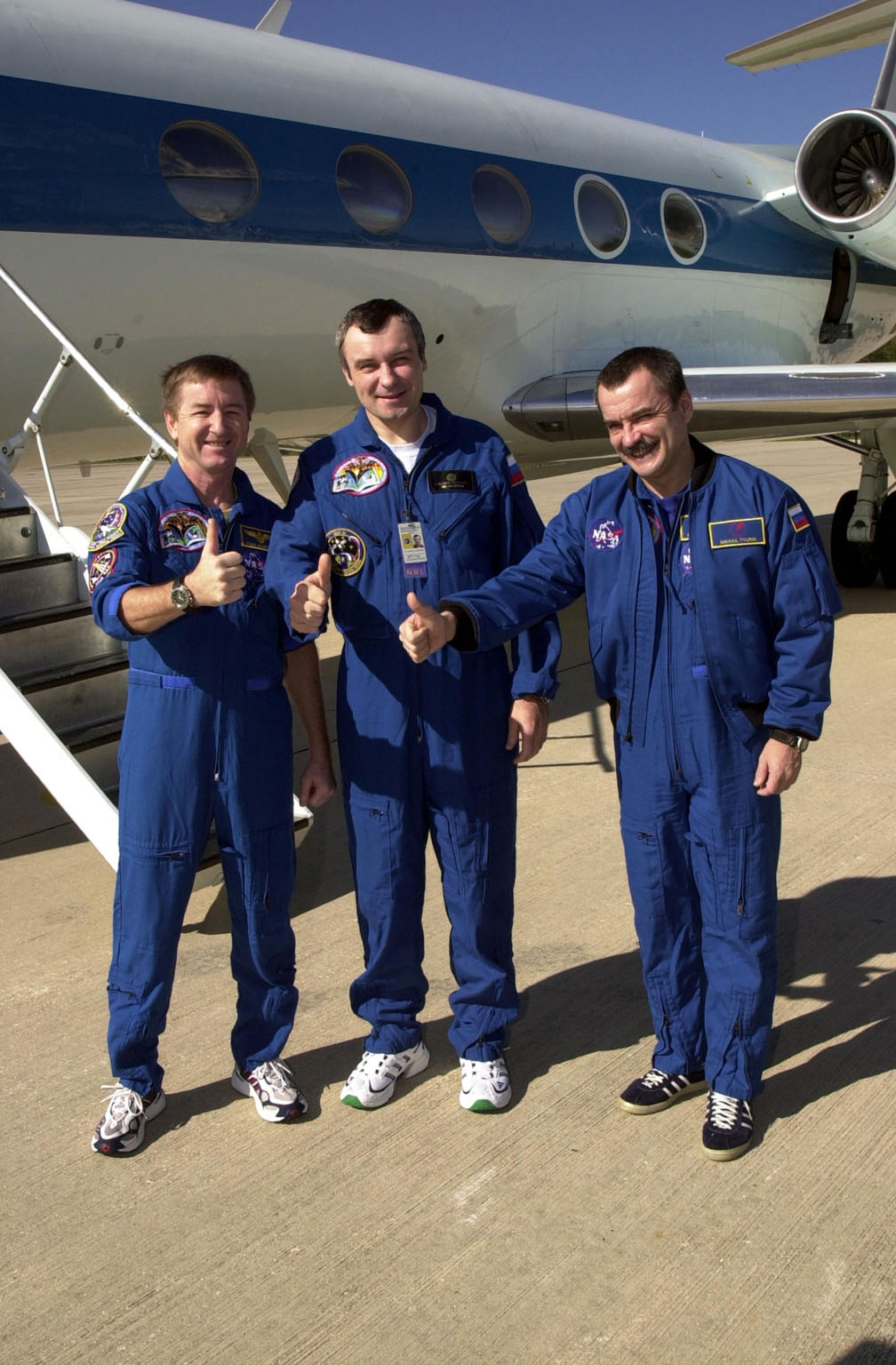 KENNEDY SPACE CENTER, FLA. -- The Expedition 3 crew show thumbs up on the verge of their departure from KSC to Houston. From left to right are Commander Frank Culbertson and cosmonauts Vladimir Dezhurov and Mikhail Tyurin. The three returned to Earth as passengers aboard the orbiter Endeavour, which landed at KSC at 12:55 p.m. EST (17:55 GMT) Dec. 17, 2001, after completing mission STS-108. Expedition 3 had spent 129 days on the International Space Station. The landing is the 57th at KSC in the history of the program STS-108 was the 12th mission to the Space Station. This mission was the 107th flight in the Shuttle program and the 17th flight for the orbiter