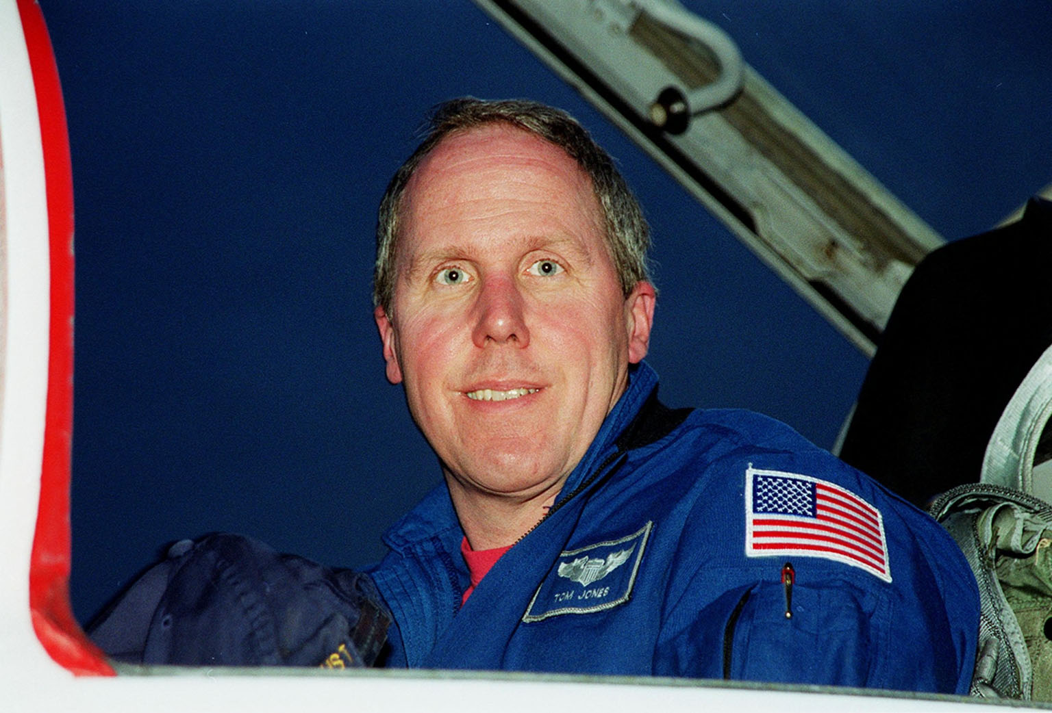 STS-98 Mission Specialist Thomas Jones happily arrives at KSC?s Shuttle Landing Facility for Terminal Countdown Test Activities. In preparation for the Jan. 19 launch, he and the rest of the crew Commander Ken Cockrell, Pilot Mark Polansky and Mission Specialists Robert Curbeam and Marsha Ivins will be training in emergency procedures from the pad, checking the payload and taking part in a simulated countdown. The payload for the mission is the U.S. Lab Destiny, a key element in the construction of the International Space Station. The lab has five system racks already installed inside the module. After delivery of electronics in the lab, electrically powered attitude control for Control Moment Gyroscopes will be activated. STS-98 is the seventh construction flight to the ISS.