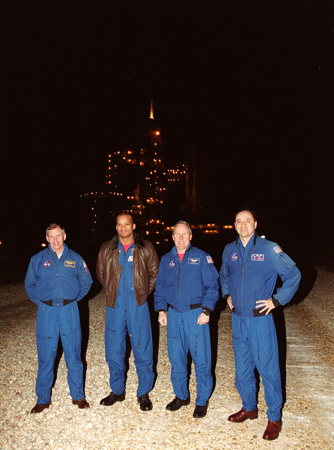 Members of the STS-98 crew pause for a photo after their arrival at KSC. From left, they are Commander Ken Cockrell, Mission Specialists Robert Curbeam and Thomas Jones, and Pilot Mark Polansky. Missing is Mission Specialist Marsha Ivins who was planning to arrive later. The crew is at KSC to take part in Terminal Countdown Test Demonstration activities in preparation for launch. They will be training in emergency procedures from the pad, checking the payload and taking part in a simulated countdown. The payload for the mission is the U.S. Lab Destiny, a key element in the construction of the International Space Station. The lab has five system racks already installed inside the module. After delivery of electronics in the lab, electrically powered attitude control for Control Moment Gyroscopes will be activated. STS-98 is the seventh construction flight to the ISS