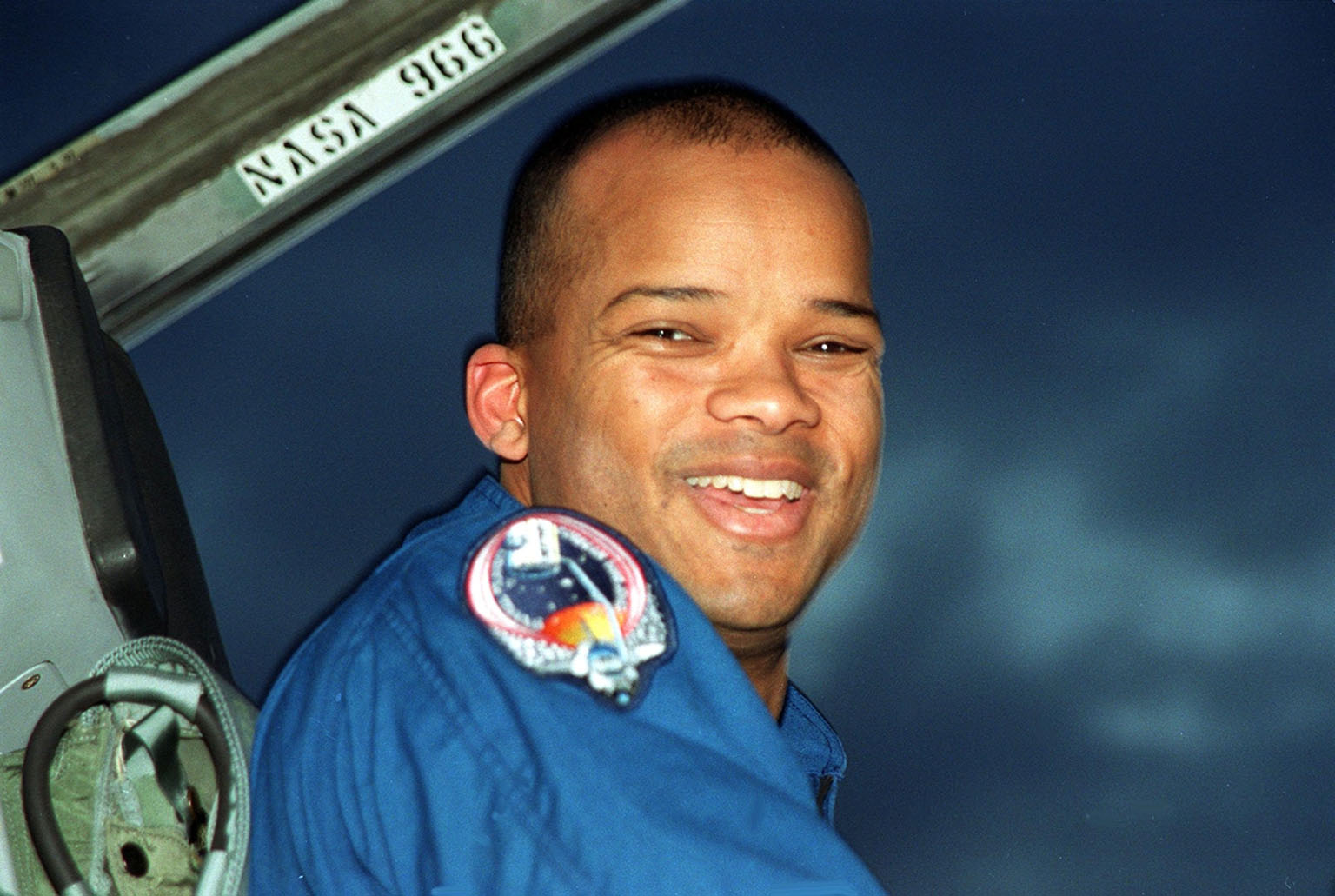 STS-98 Mission Specialist Robert Curbeam grins after his arrival at KSC?s Shuttle Landing Facility for Terminal Countdown Test Activities. In preparation for the Jan. 19 launch, he and the rest of the crew Commander Ken Cockrell, Pilot Mark Polansky and Mission Specialists Thomas Jones and Marsha Ivins will be training in emergency procedures from the pad, checking the payload and taking part in a simulated countdown. The payload for the mission is the U.S. Lab Destiny, a key element in the construction of the International Space Station. The lab has five system racks already installed inside the module. After delivery of electronics in the lab, electrically powered attitude control for Control Moment Gyroscopes will be activated. STS-98 is the seventh construction flight to the ISS.