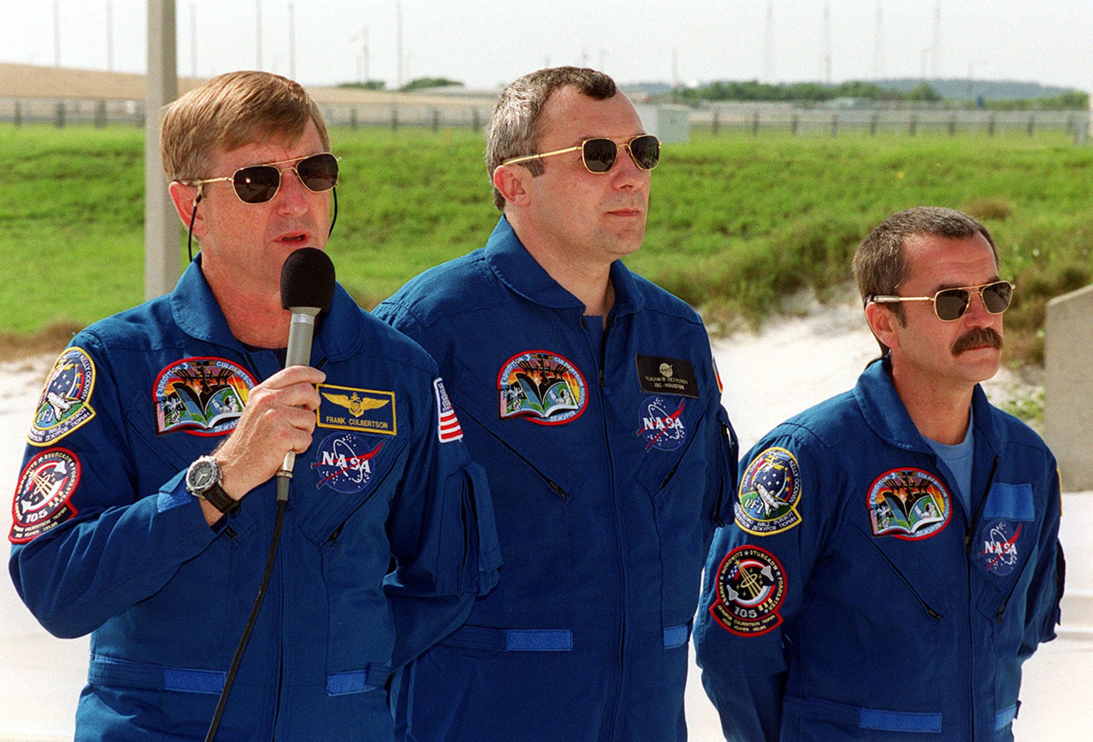 KENNEDY SPACE CENTER, Fla. -- At the slidewire landing site, Launch Pad 39A, Expedition Three Commander Frank Culbertson responds to a question during a media interview. With him are cosmonauts Vladimir Nikolaevich Dezhurov (center) and Mikhail Tyurin (right), who are with the Russian Aviation and Space Agency. They and the STS-105 crew are at KSC to take part in Terminal Countdown Demonstration Test activities, which include emergency egress, a simulated launch countdown and familiarization with the payload. Mission STS-105 will be transporting the Expedition Three crew, several payloads and scientific experiments to the International Space Station aboard Discovery. The current Expedition Two crew members on the Station will return to Earth on Discovery. Launch of Discovery is scheduled no earlier than Aug. 9, 2001