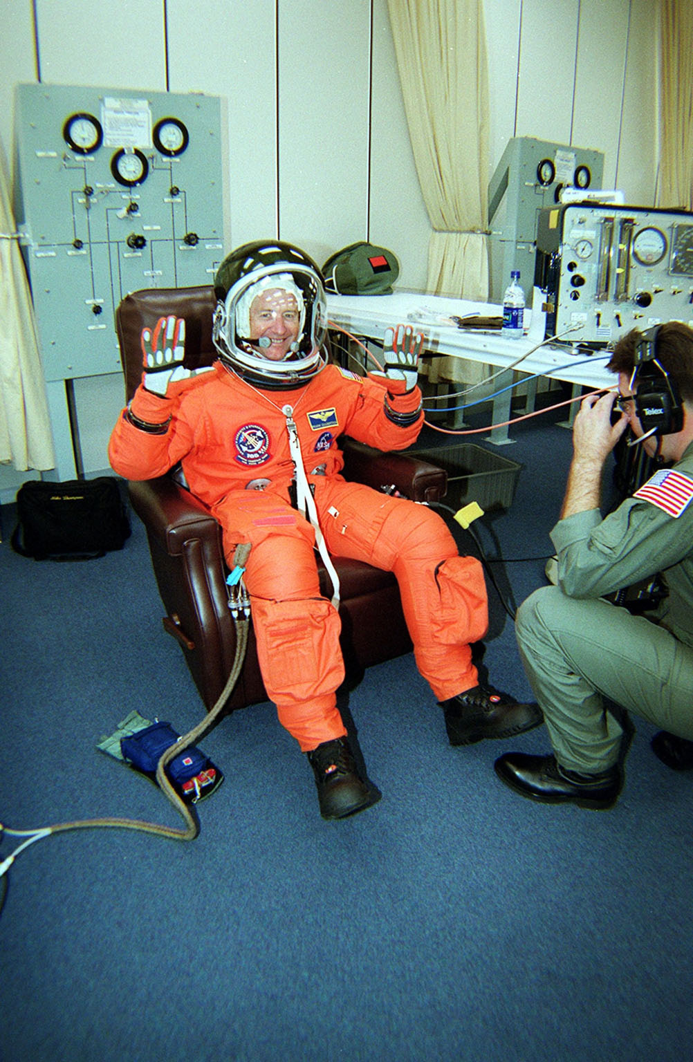 KENNEDY SPACE CENTER, Fla. -- Expedition Three Commander Frank Culbertson shows his eagerness for liftoff while suiting up in his launch and entry suit. On mission STS-105, Discovery will be transporting the Expedition Three crew and several scientific experiments and payloads to the International Space Station, including the Early Ammonia Servicer (EAS) tank. The EAS, which will support the thermal control subsystems until a permanent system is activated, will be attached to the Station during two spacewalks. The three-member Expedition Two crew will be returning to Earth aboard Discovery after a five-month stay on the Station. Launch is scheduled for 5:38 p.m. EDT Aug. 9