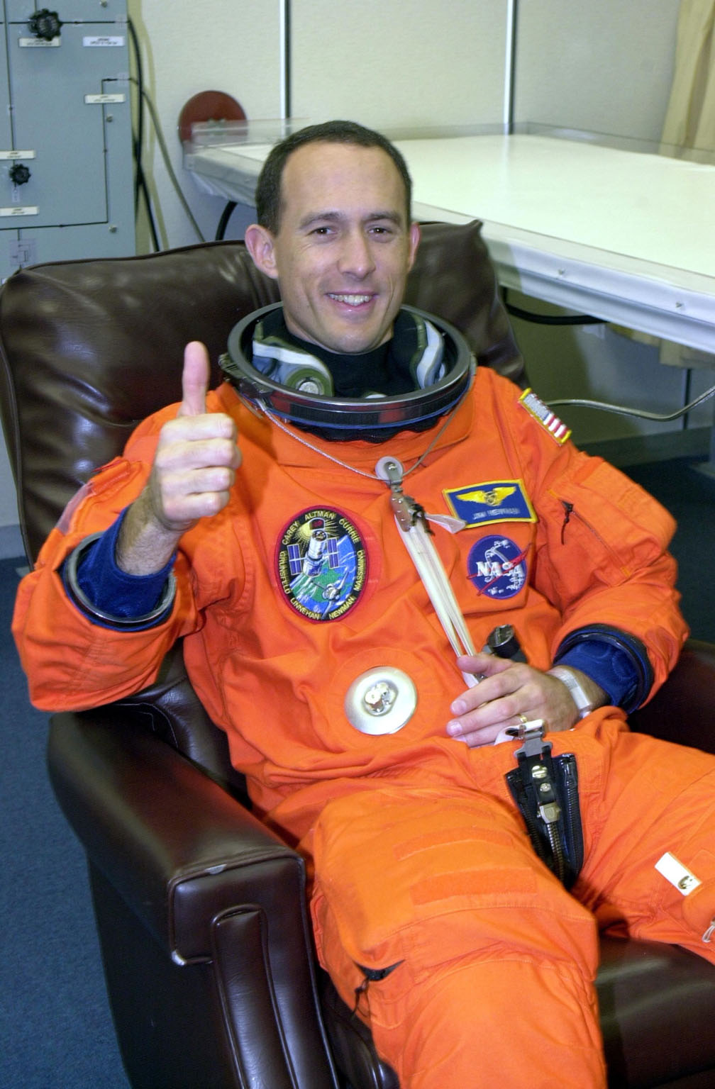 KENNEDY SPACE CENTER, Fla. - During suitup, STS-109 Mission Specialist James H. Newman gives a thumbs up for launch. Liftoff of Space Shuttle Columbia is scheduled for 6:22 a.m. EST March 1. On mission STS-109, the crew will capture the Hubble Space Telescope using the Shuttle's robotic arm and secure it on a workstand in Columbia's payload bay. Four mission specialists will perform five scheduled spacewalks to complete system upgrades to the telescope. More durable solar arrays, a large gyroscopic assembly to help point the telescope properly, a new telescope power control unit, and a cooling system to restore the use of a key infrared camera and spectrometer unit, which has been dormant since 1999, will all be installed. In addition, the telescope's view of the Universe will be improved with the addition of the Advanced Camera for Surveys (ACS), which replaces the Faint Object Camera, the last of Hubble's original instruments. Mission STS-109 is the 27th flight of the orbiter Columbia and the 108th flight overall in NASA's Space Shuttle program. After the 11-day mission, Columbia is scheduled to land about 4:35 a.m. EST March 12