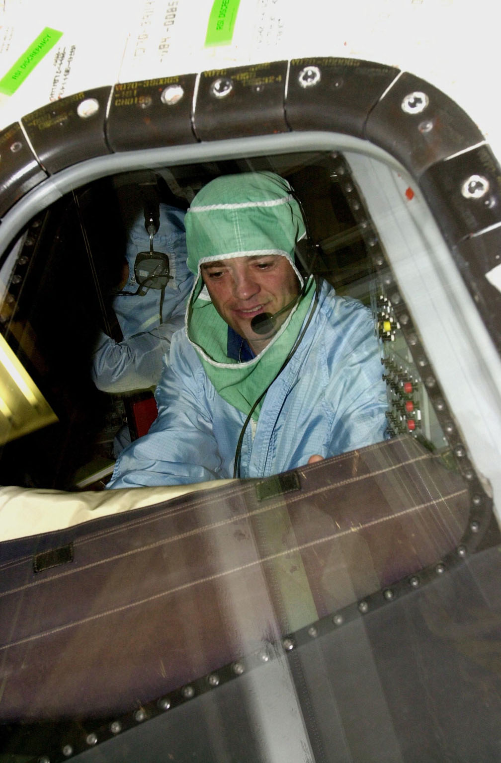 KENNEDY SPACE CENTER, FLA. -- During a Crew Equipment Interface Test, STS-112 Commander Jeffrey Ashby checks out the windshield on Atlantis, the designated orbiter for the mission. STS-112 is the 15th assembly flight to the International Space Station and will be ferrying the S1 Integrated Truss Structure. The S1 truss is the first starboard (right-side) truss segment, whose main job is providing structural support for the radiator panels that cool the Space Station's complex power system. The S1 truss segment also will house communications systems, external experiment positions and other subsystems. The S1 truss will be attached to the S0 truss. STS-112 is currently scheduled for launch Aug. 22, 2002