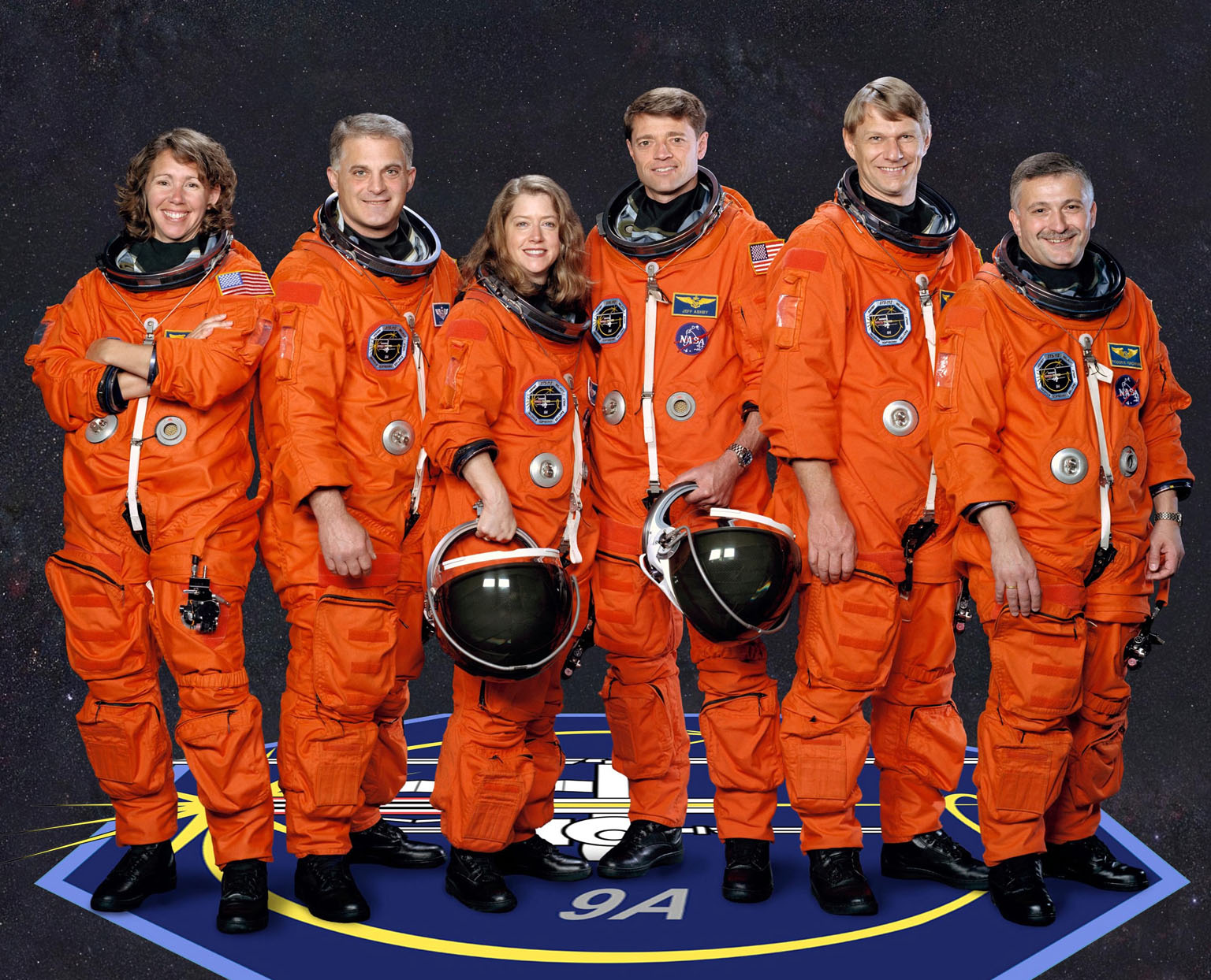 JOHNSON SPACE CENTER, HOUSTON, TEXAS -- (STS112-S-002) These five astronauts and cosmonaut take a break from training to pose for the STS-112 crew portrait. Astronauts Pamela A. Melroy and Jeffrey S. Ashby, pilot and commander respectively, are in the center of the photo. The mission specialists are from left to right, astronauts Sandra H. Magnus, David A. Wolf and Piers J. Sellers, and cosmonaut Fyodor Yurchikhin, who represents Rosaviakosmos.