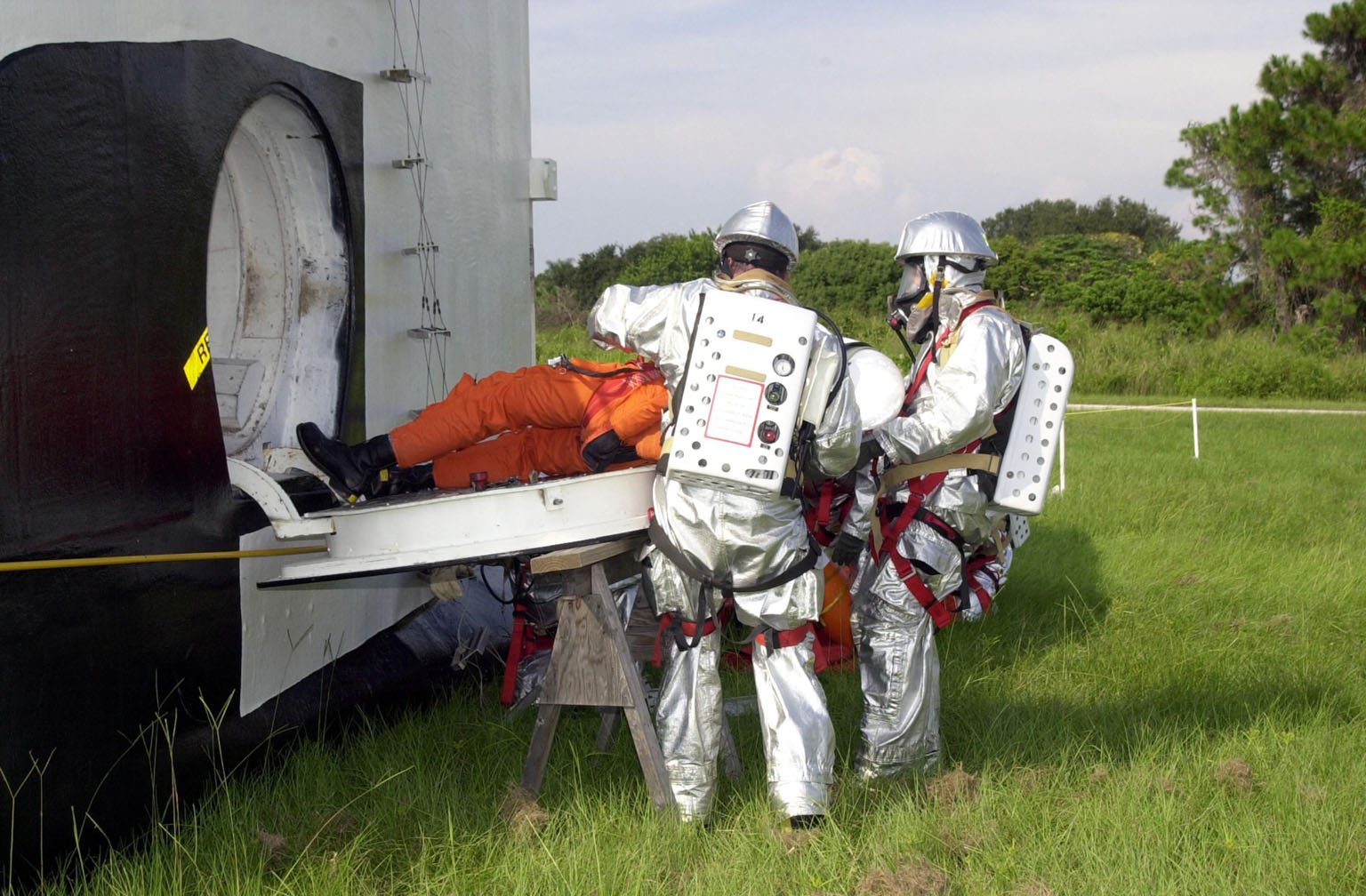 """KENNEDY SPACE CENTER, FLA. - """"Astronauts"""" were safely and successfully recovered from a """"downed"""" Space Shuttle in a Mode VII contingency simulation led by Don Hammel, NASA Landing and Recovery Director. KSC Fire/Rescue and Emergency Medical workers, along with Johnson Space Center and Patrick Air Force Base personnel, participated in the drill. Mode simulations are held periodically at KSC to ensure contingency response forces are well prepared to respond to a wide variety of potential emergency situations."""